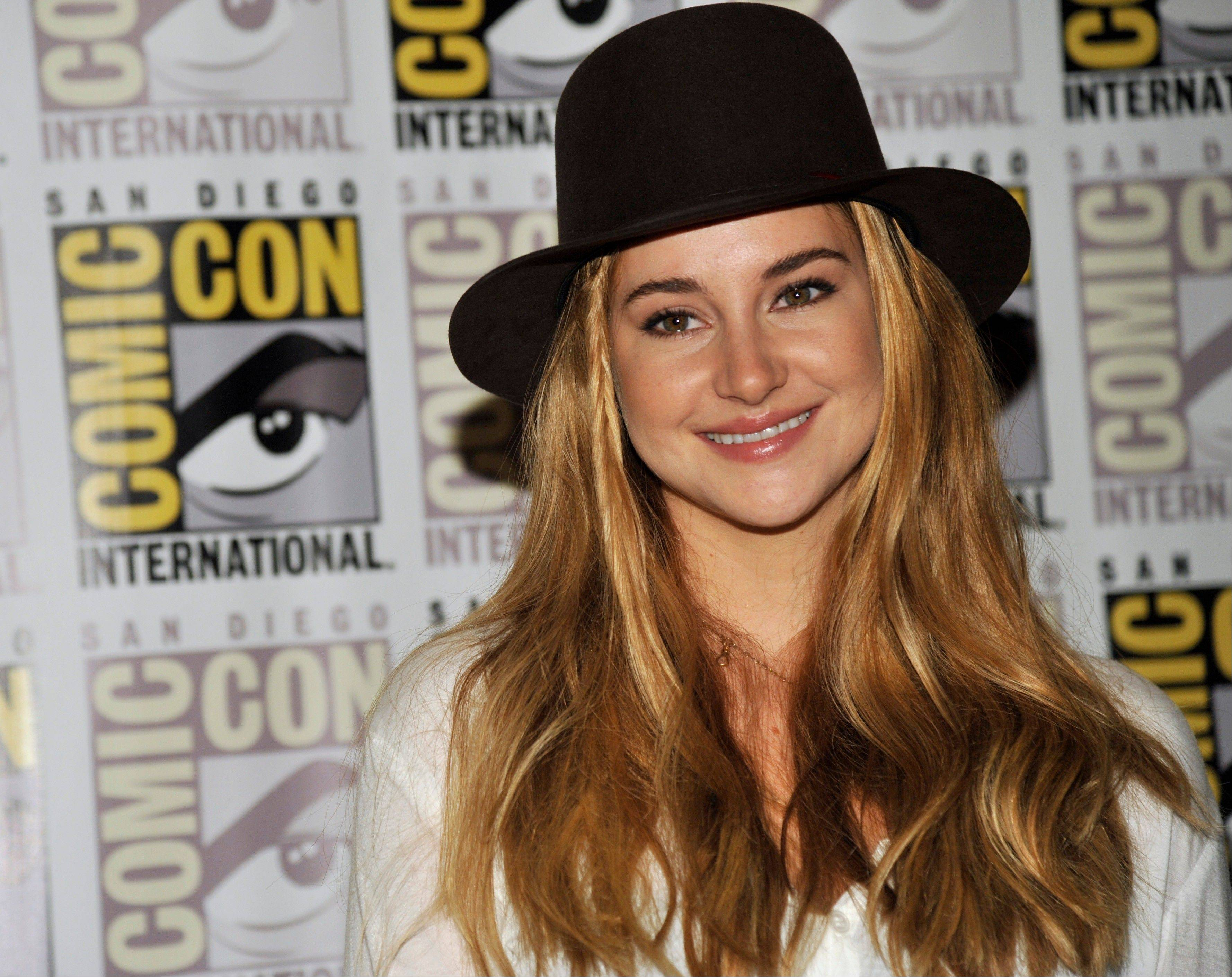 "Shailene Woodley attends the ""Divergent"" press line Thursday at Comic-Con International in San Diego. ""Divergent,"" based on a series of novels by Veronica Roth, opens March 21, 2014, in theaters and also stars Kate Winslet."