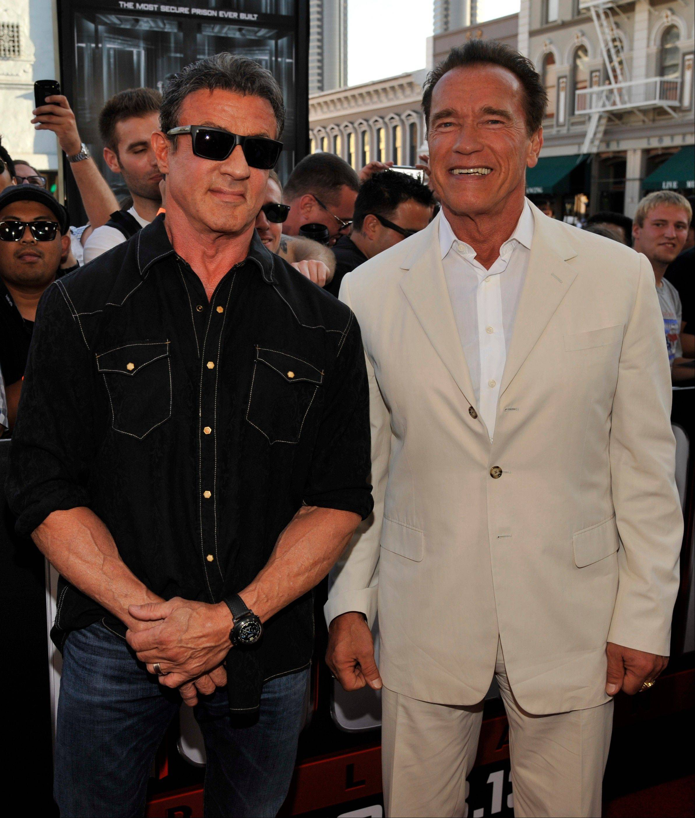 "Sylvester Stallone, left, and Arnold Schwarzenegger arrive at the ""Escape Plan"" special screening Thursday at Comic-Con International in San Diego. The film opens Oct. 18 in theaters."