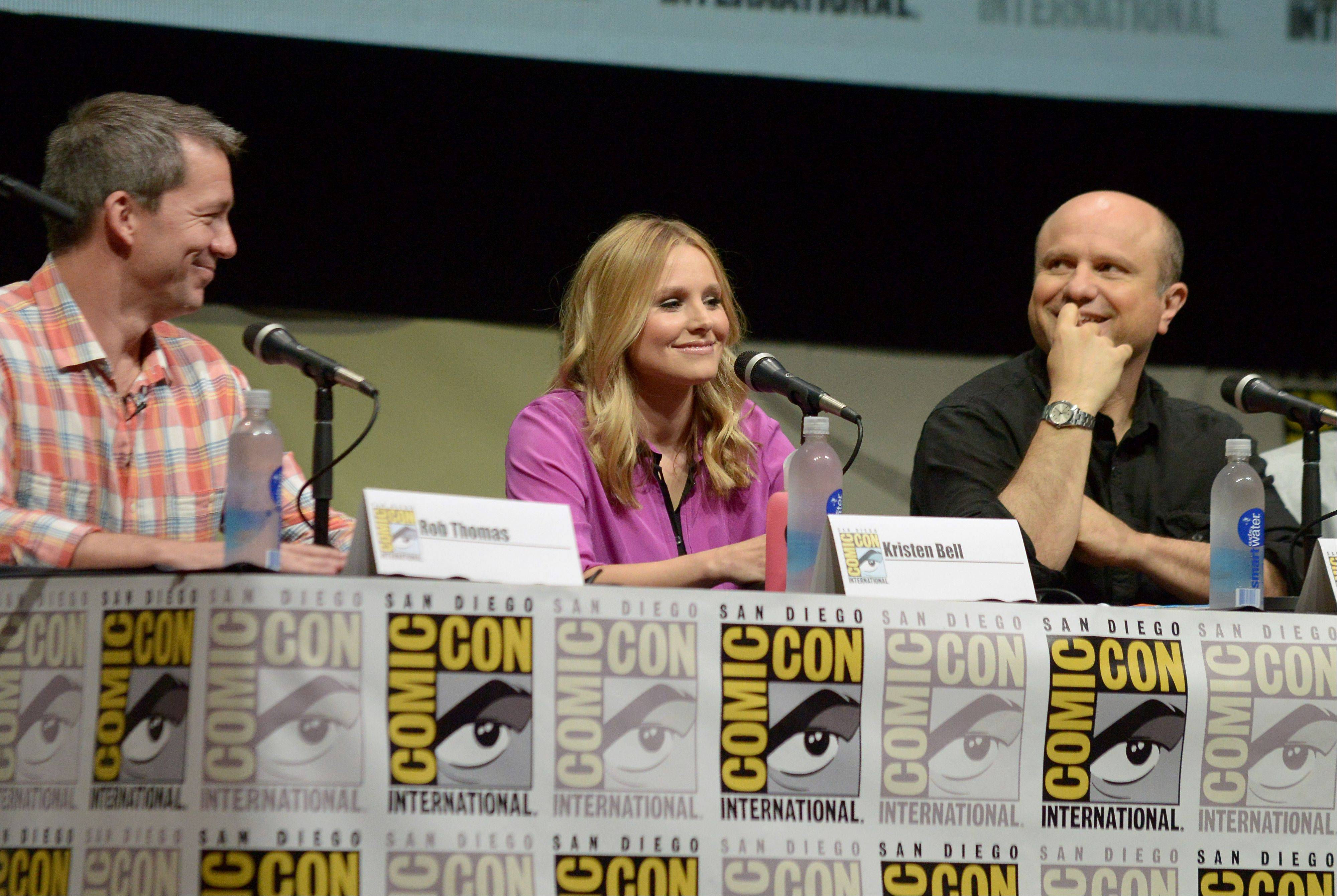 "From left, writer Rob Thomas and actors Kristen Bell and Enrico Colantoni participate in the ""Veronica Mars"" panel Friday at Comic-Con International in San Diego."