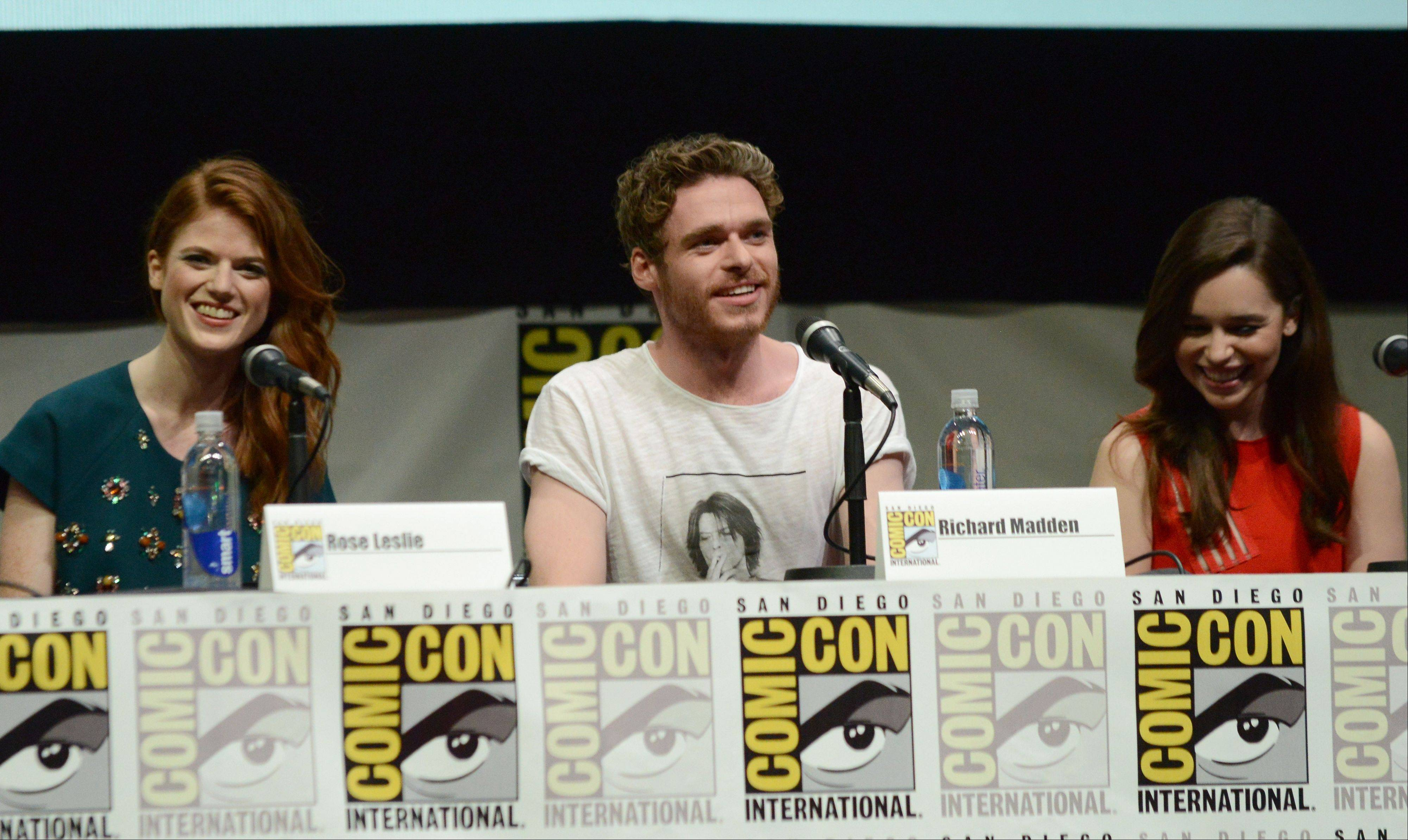 """Game of Thrones"" stars Rose Leslie (Ygritte), Richard Madden (Robb Stark) and Emilia Clarke (Daenerys Targaryen) participate in their show's panel Friday at Comic-Con International in San Diego."