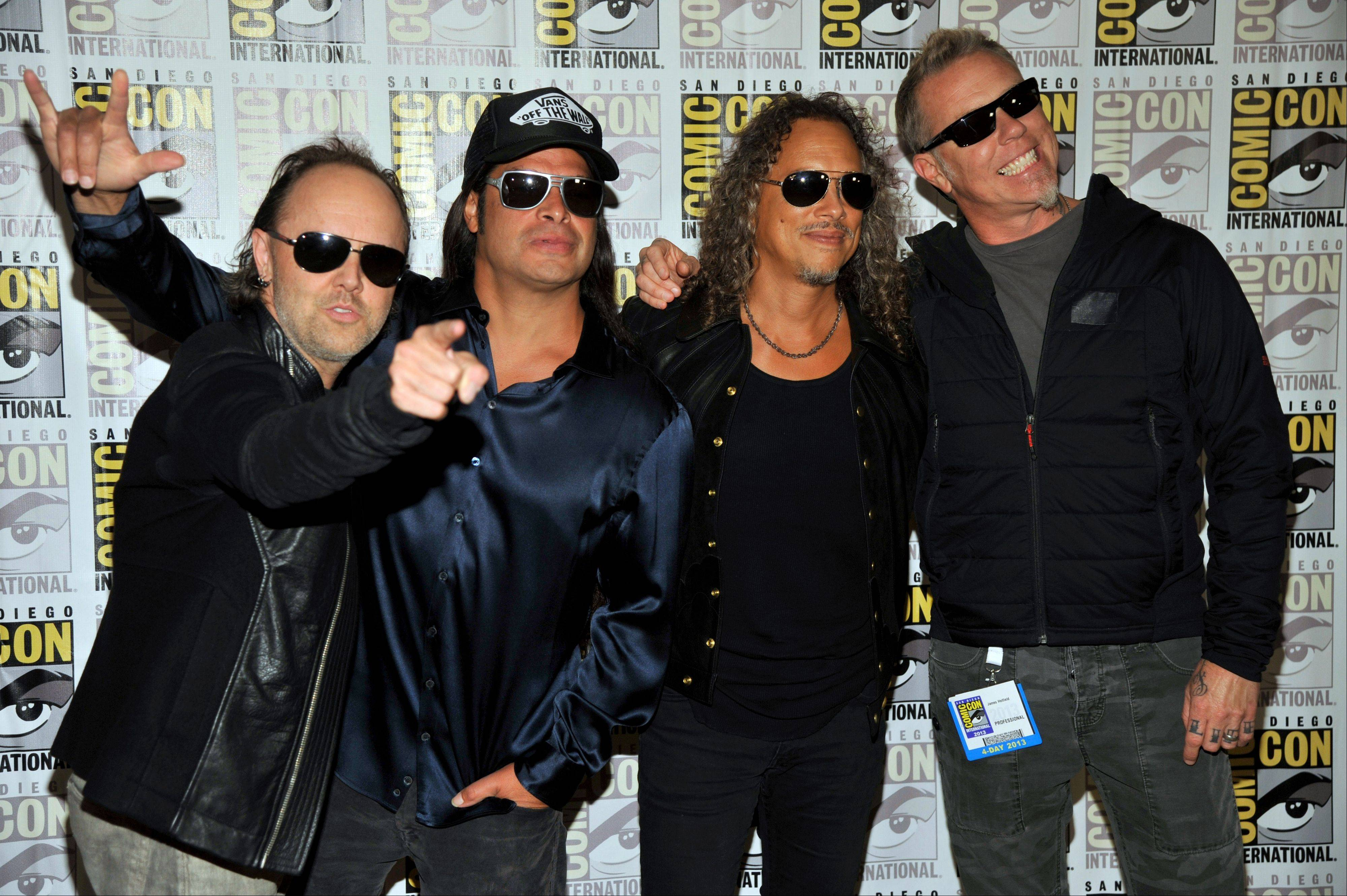 "From left, Lars Ulrich, Robert Trujillo, Kirk Hammett and James Hetfield of Metallica, arrive Friday at Comic-Con International in San Diego. The band's new 3D concert film, ""Metallica: Through the Never,"" opens Sept. 27 in theaters."