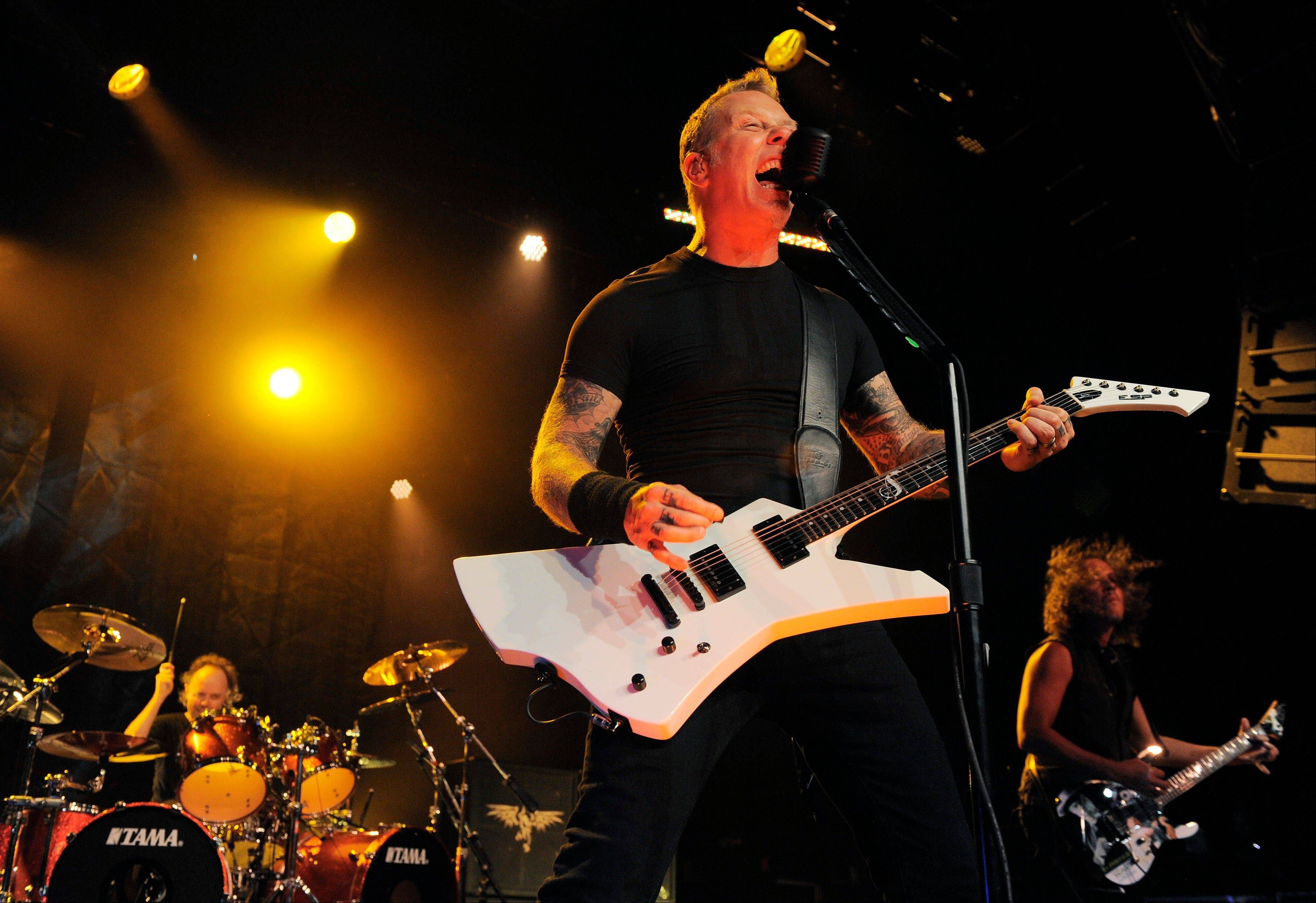 Lars Ulrich, from left, James Hetfield and Kirk Hammett of Metallica perform Friday at Comic-Con International in San Diego.