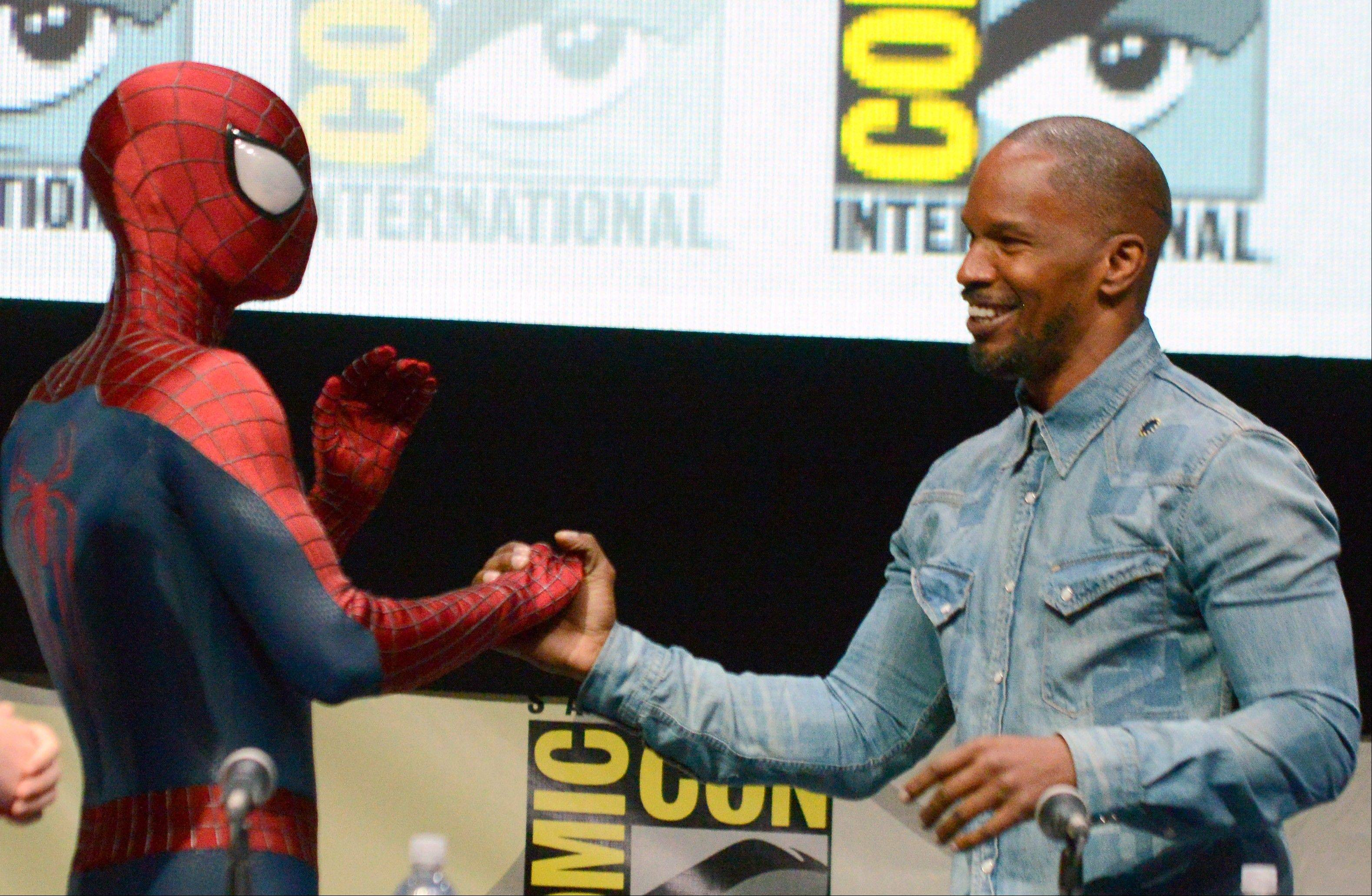 "Spider-Man, aka actor Andrew Garfield, and Jamie Foxx (Electro) attend the ""The Amazing Spider-Man 2"" panel Friday at Comic-Con International in San Diego."