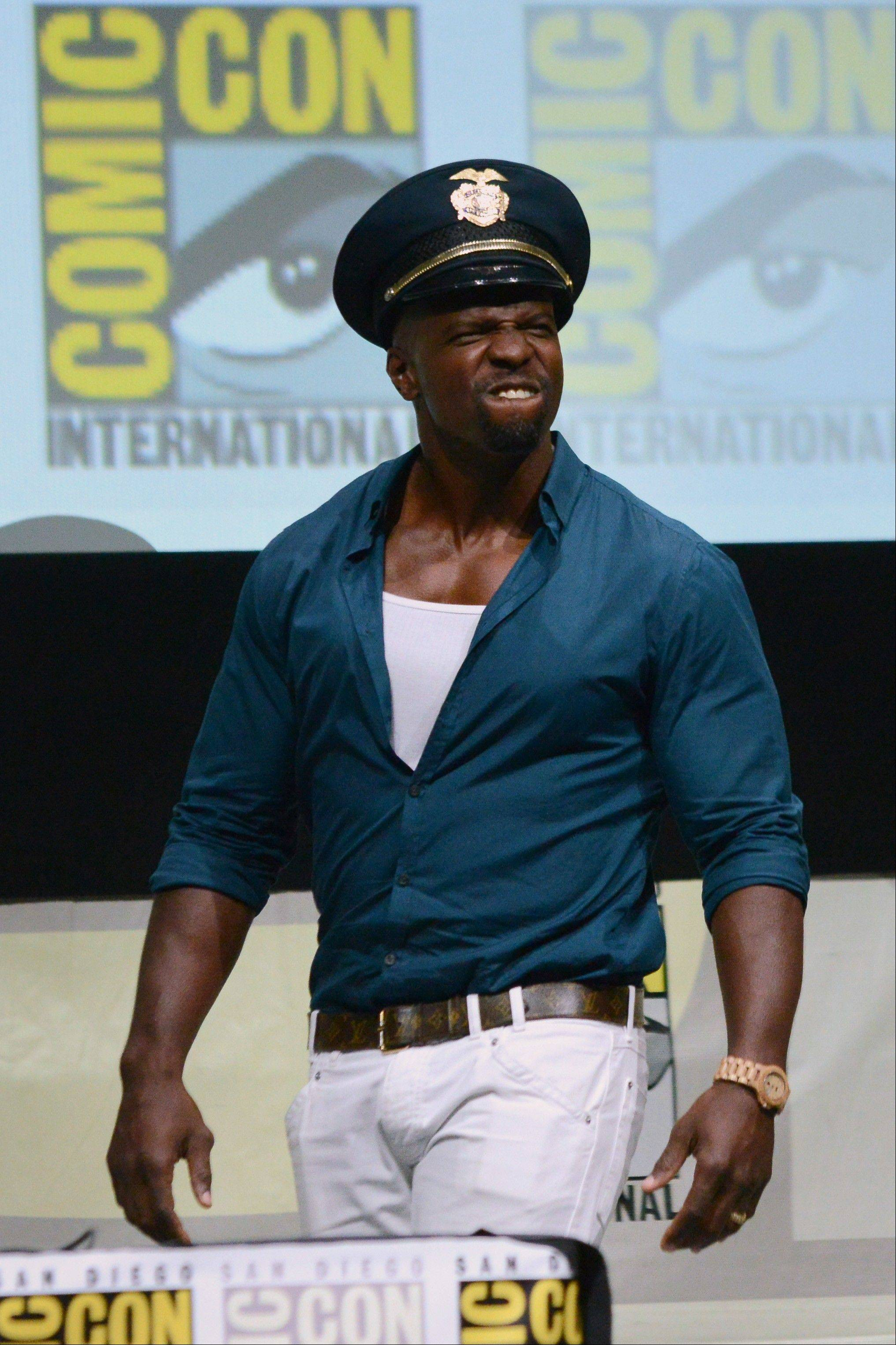 "Terry Crews attends the ""Cloudy with a Chance of Meatballs 2"" panel on Day 3 of Comic-Con International on Friday, July 19, 2103 in San Diego, Calif. (Photo by Jordan Strauss/Invision/AP)"