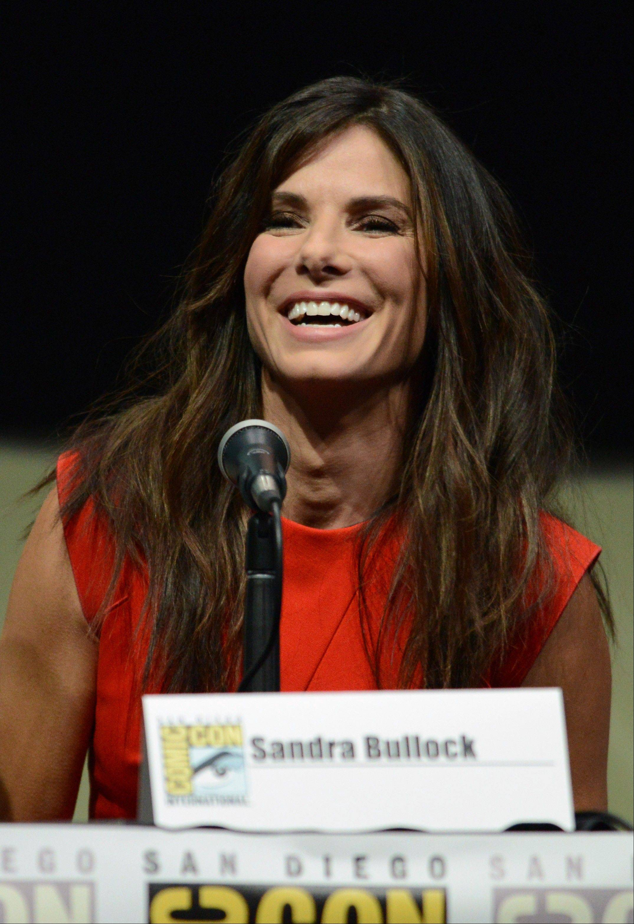 "Sandra Bullock attends the panel for her new science-fiction film ""Gravity"" on Saturday during Day 4 of Comic-Con International in San Diego. ""Gravity"" opens Oct. 4 in theaters."