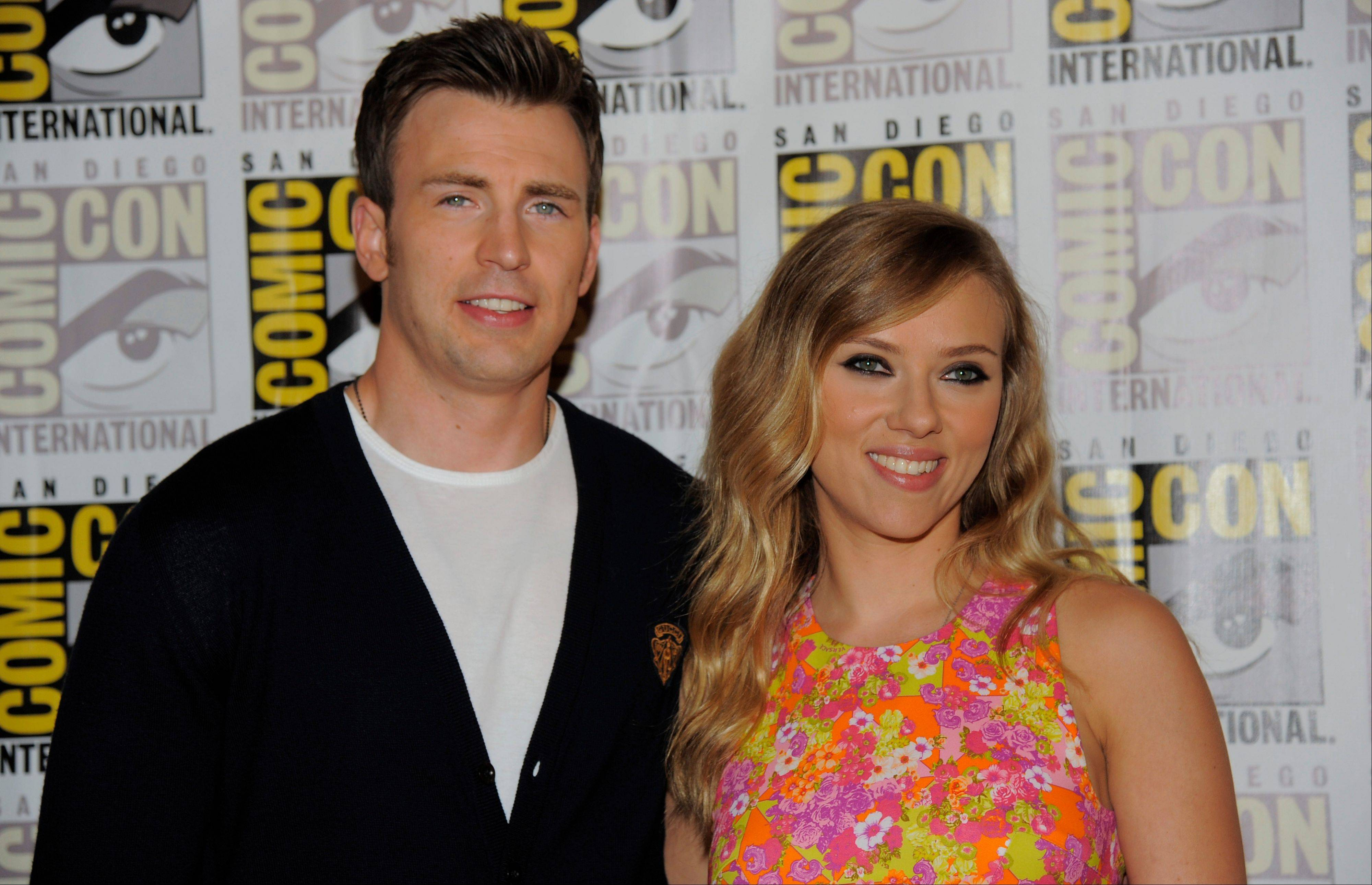 "Chris Evans (Captain America), left, and Scarlett Johansson (Black Widow) attend the ""Captain America:The Winter Soldier"" press line Saturday on Day 4 of Comic-Con International in San Diego. ""Captain America: The Winter Soldier"" opens April 4, 2014, in theaters."