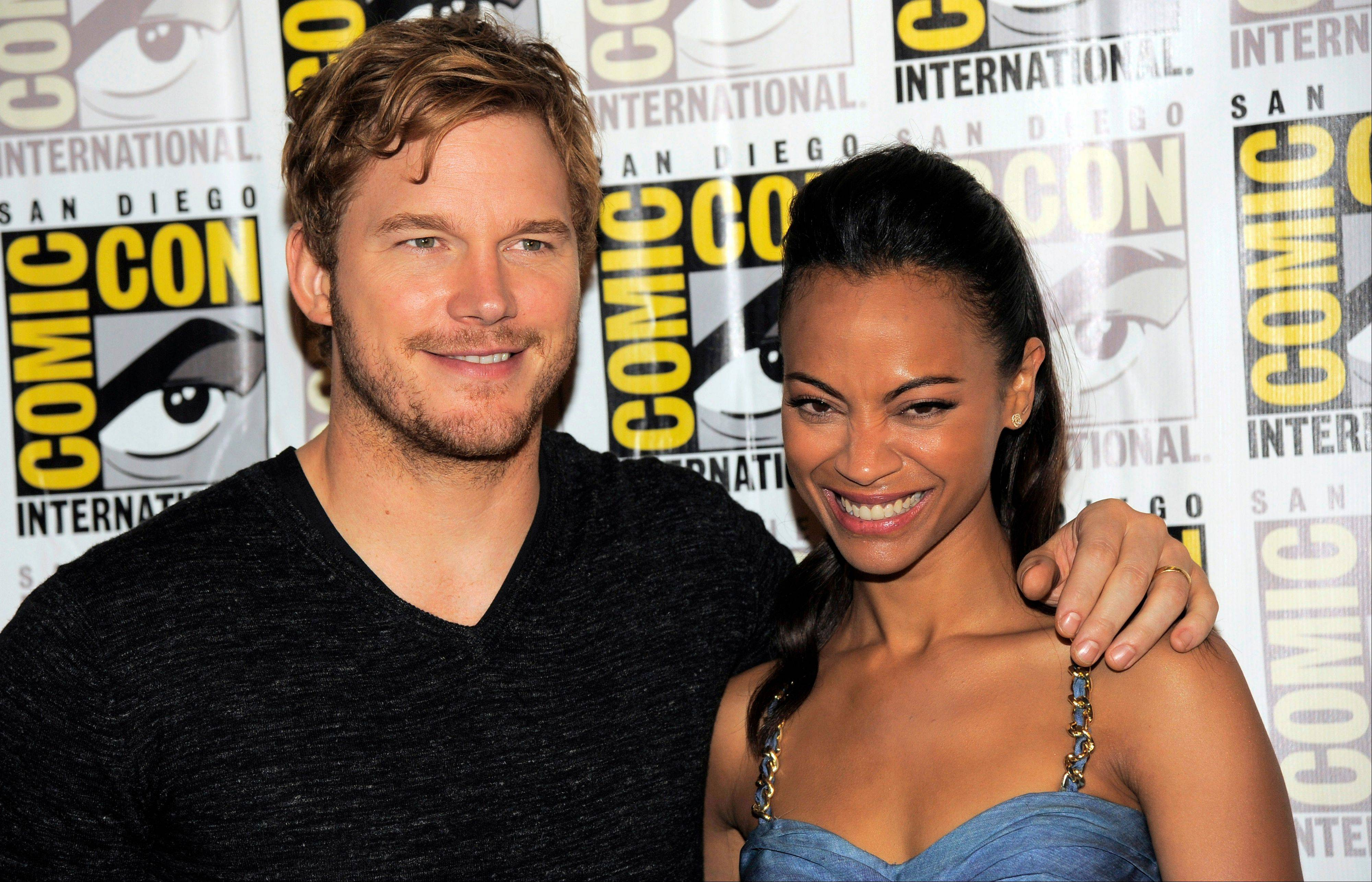 "Chris Pratt (Star Lord), left, and Zoe Saldana (Gamora) pose at the panel for their film ""Guardians of the Galaxy"" Saturday at Comic-Con International in San Diego. ""Guardians of the Galaxy"" opens Aug. 1, 2014, in theaters."