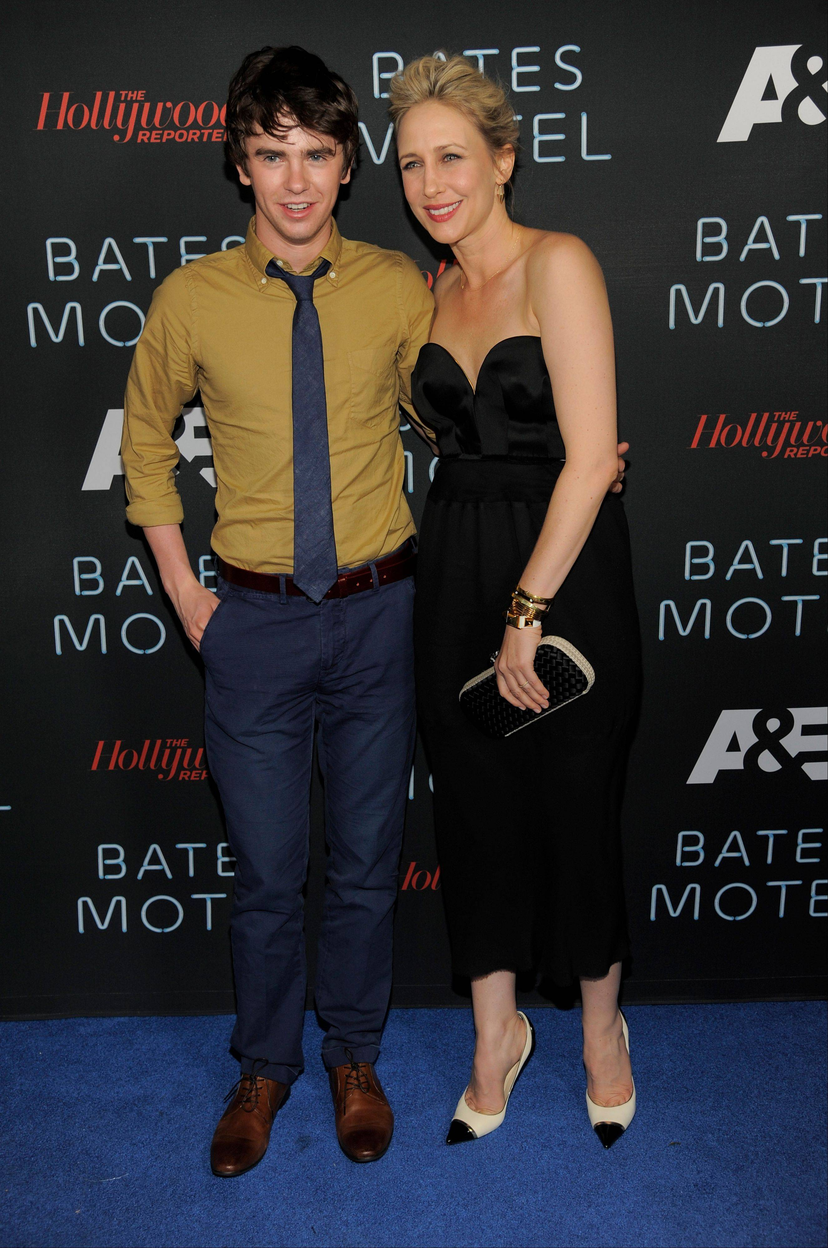 "Freddie Highmore (Norman Bates), left, and Vera Farmiga (Norma Bates) arrive Saturday at the ""Bates Motel Party"" presented by A&E and the Hollywood Reporter at Comic-Con International in San Diego."