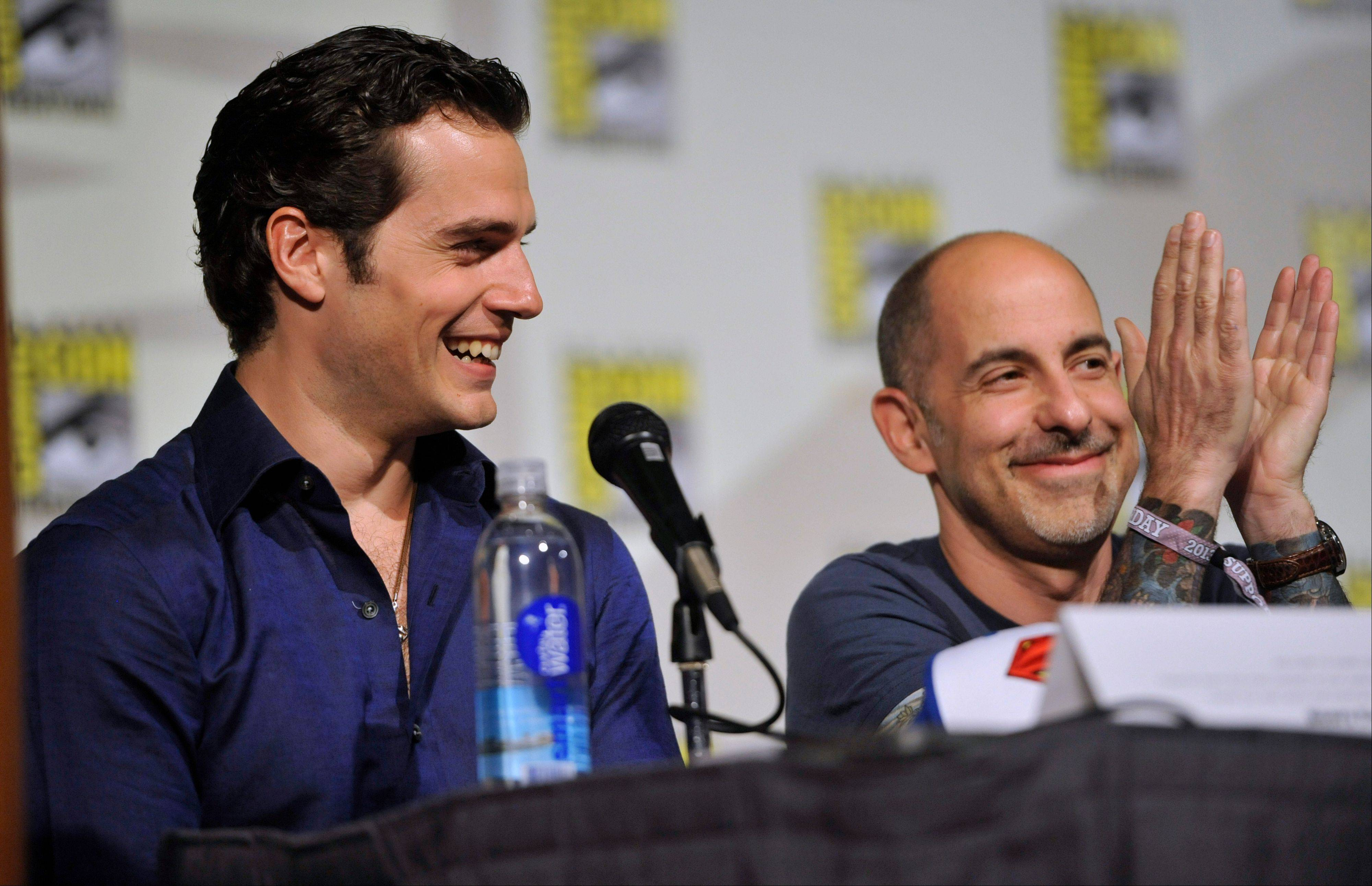 """Man of Steel"" star Henry Cavill, left, and writer/producer David Goyer attend the ""Superman"" 75th Anniversary panel Saturday at Comic-Con International in San Diego."