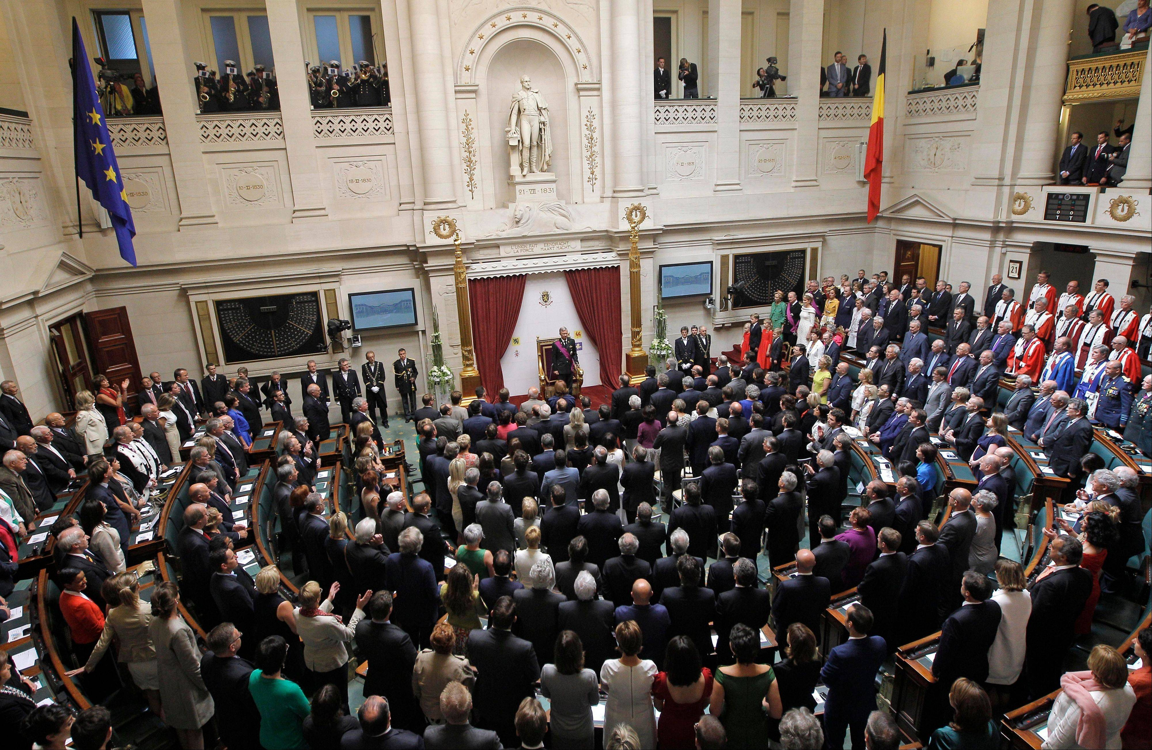Belgium's Prince Philippe, center rear, prepares to take the oath in front of members of the parliament and senate at the Palace of the Nation in Brussels on Sunday, July 21, 2013. Philippe has taken the oath before parliament to become Belgium's seventh king after his father Albert II abdicated as the head of this fractured nation. Earlier Sunday, the 79-year-old Albert signed away his rights as the kingdom's largely ceremonial ruler at the royal palace in the presence of Prime Minister Elio Di Rupo, who holds the political power in this 183-year-old parliamentary democracy.
