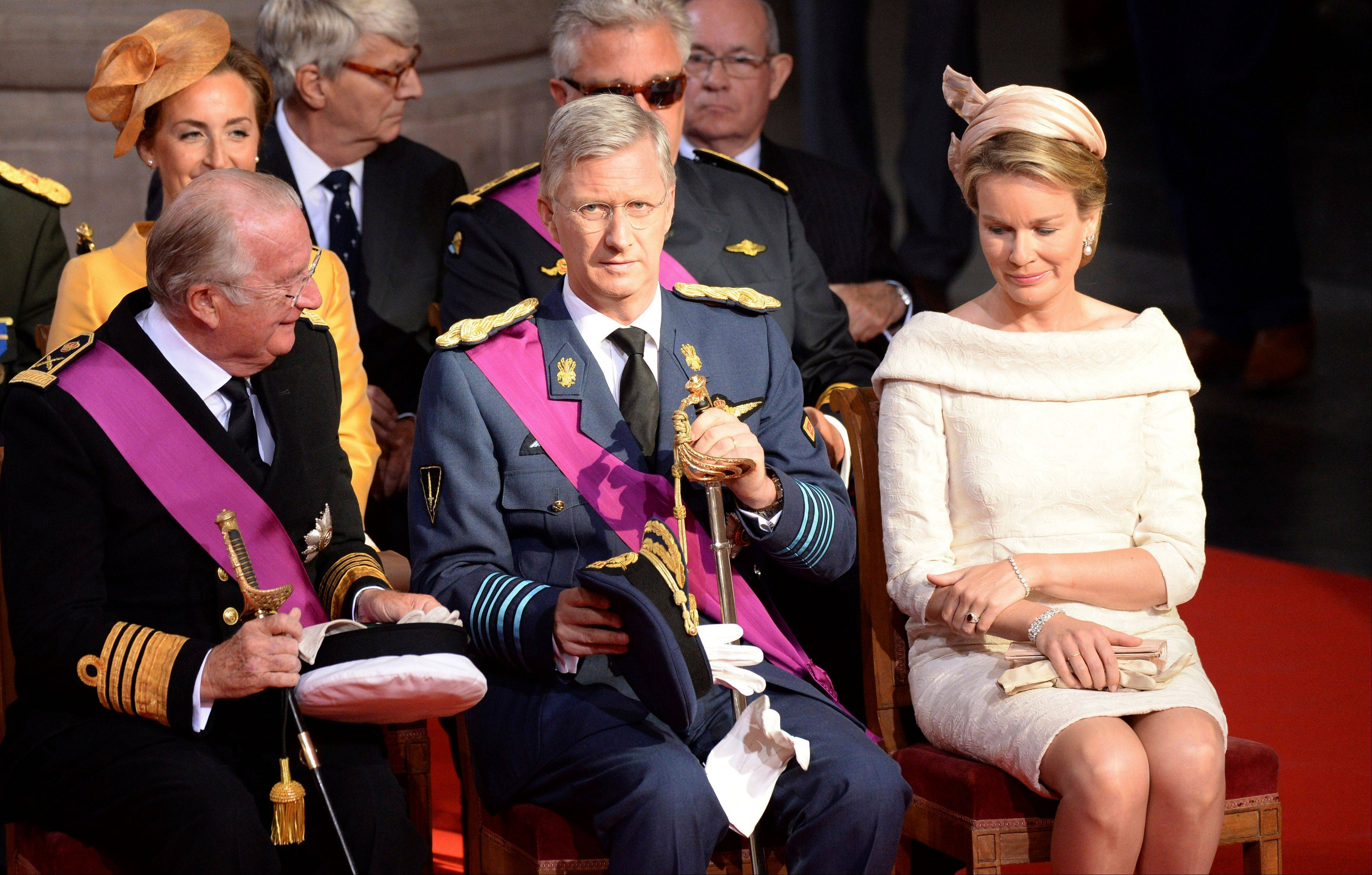 Belgium's King Albert II, left, Prince Philippe, center, and his wife Princess Mathilde attend a church service at the St. Gudule cathedral in Brussels on Sunday, July 21, 2013. Belgium's King Albert II was set Sunday to relinquish the throne in a concession to his age and health, paving the way for his eldest son to become the country's seventh monarch.