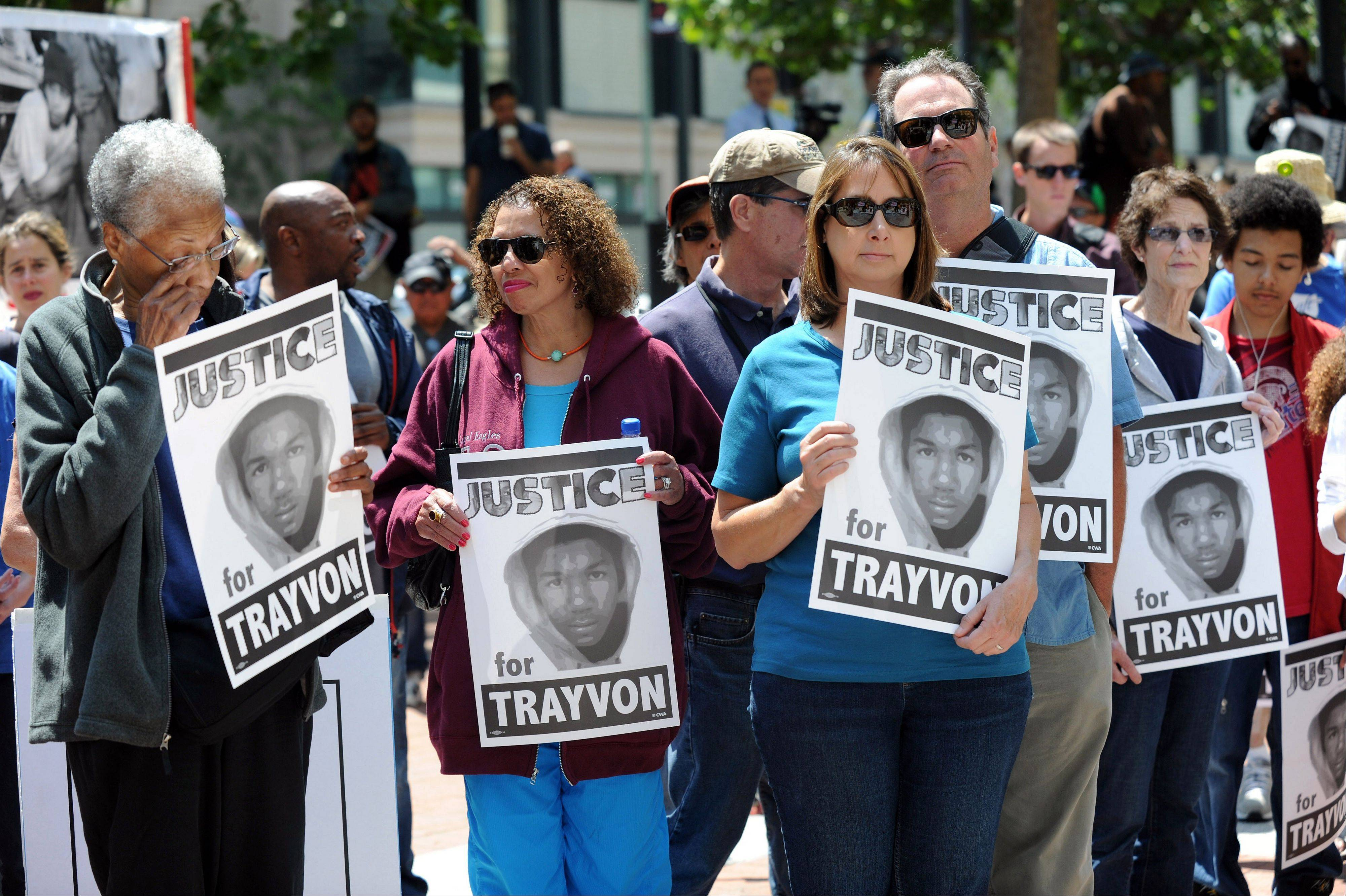 "People gather at the Ronald V. Dellums Federal Building in Oakland, Calif. on Saturday, July 20, 2013. The Rev. Al Sharpton's National Action Network organized ""Justice for Trayvon"" rallies nationwide to press for federal civil rights charges against George Zimmerman, who was found not guilty in the shooting death of unarmed teenager Trayvon Martin."