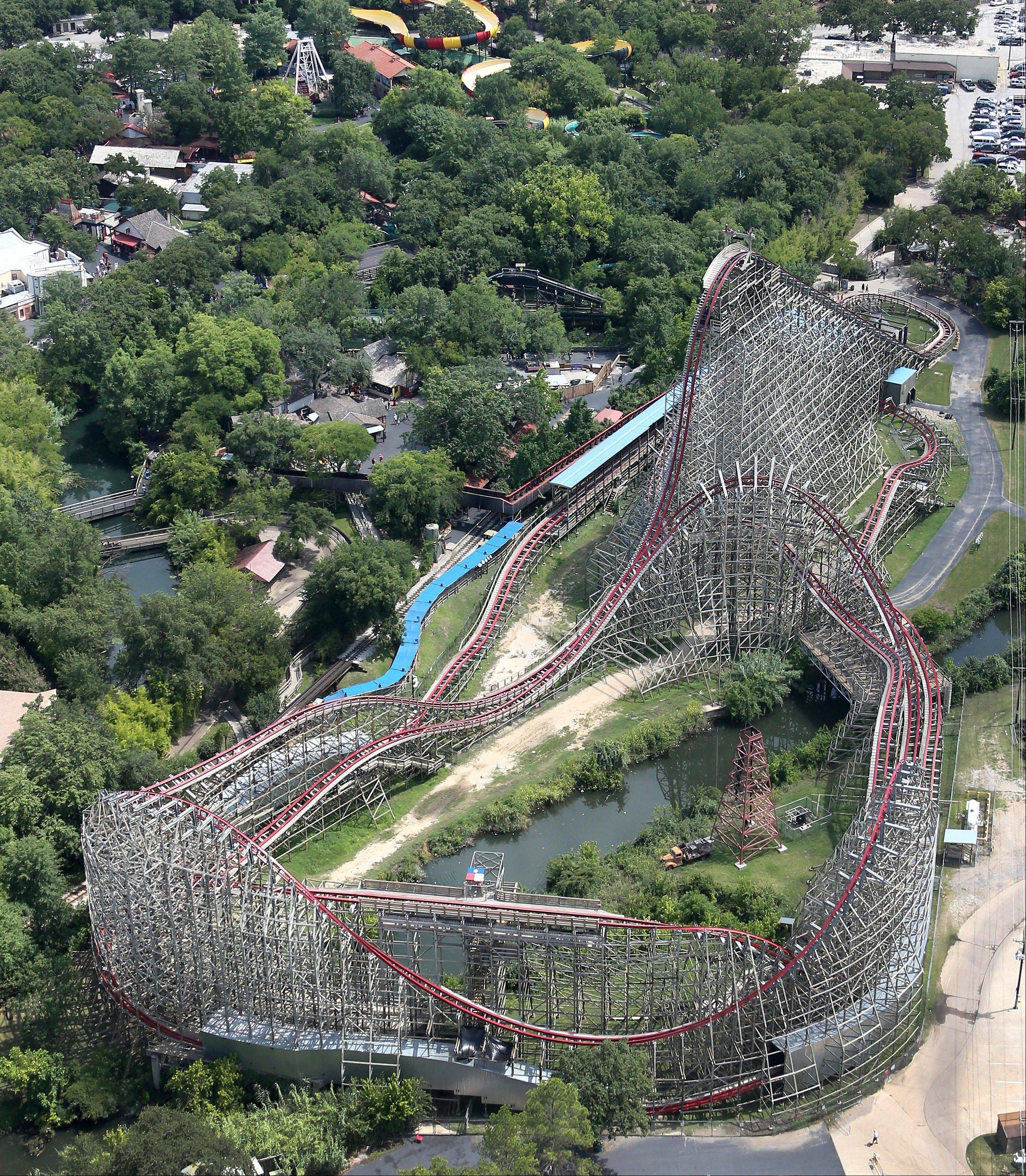 This aerial photo shows the Texas Giant roller coaster at Six Flags Over Texas where a woman fell to her death Saturday in Arlington, Texas. Investigators will try to determine if the woman fell from the ride after, some witnesses said, she wasn't properly secured.