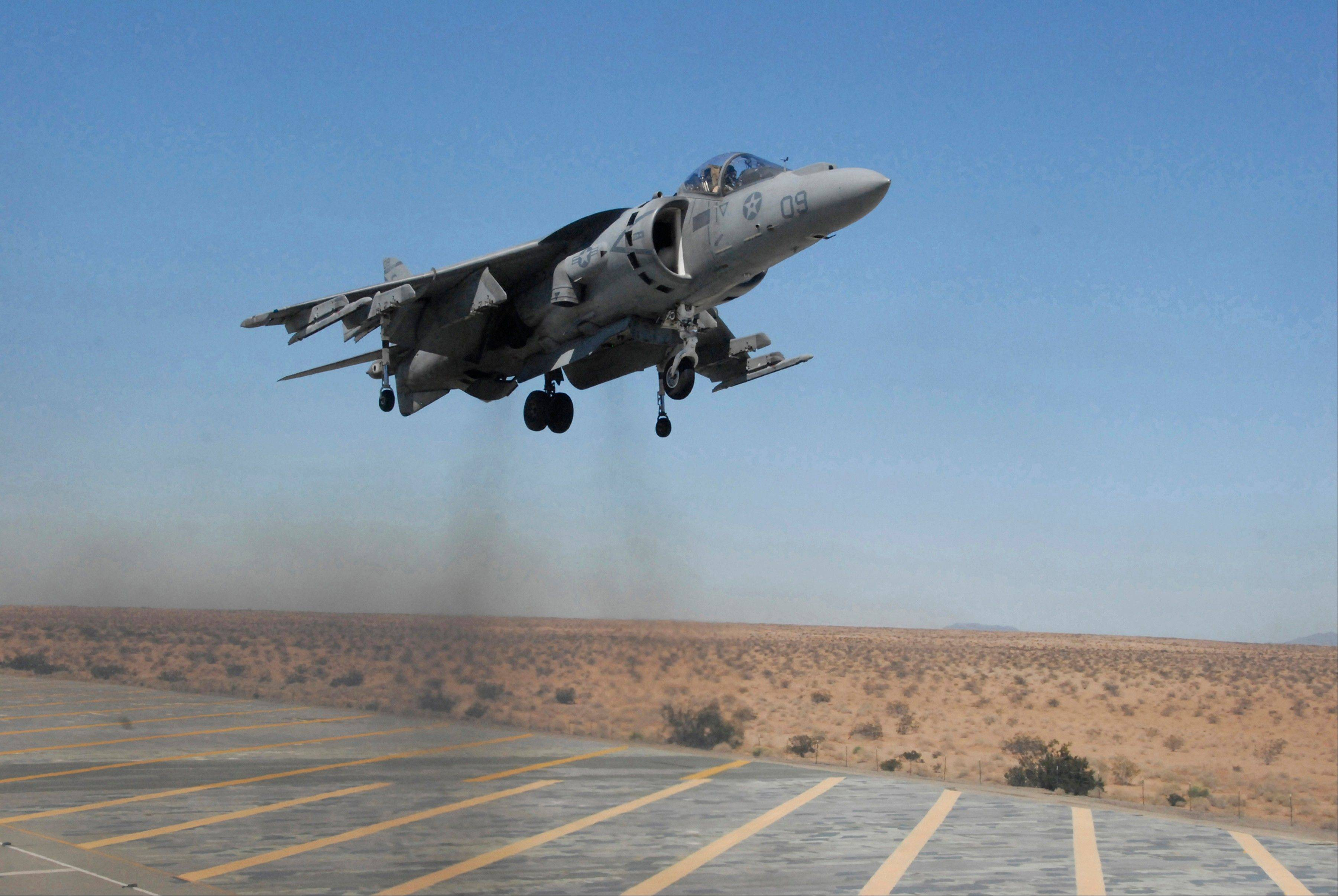 In this Sept. 12, 2008 file photo provided by the U.S. Marine Corps., Capt. Andrew D'Ambrogi, Marine Attack Squadron 211 pilot, prepares to land an AV-8B Harrier at Auxiliary Airfield II, a simulated amphibious assault ship flight deck on the Barry M. Goldwater Range in Yuma, Ariz. Two U.S. fighter jets have dropped four unarmed bombs in Australia's Great Barrier Reef Marine Park when a training exercise went wrong, Tuesday, July 16, 2013.