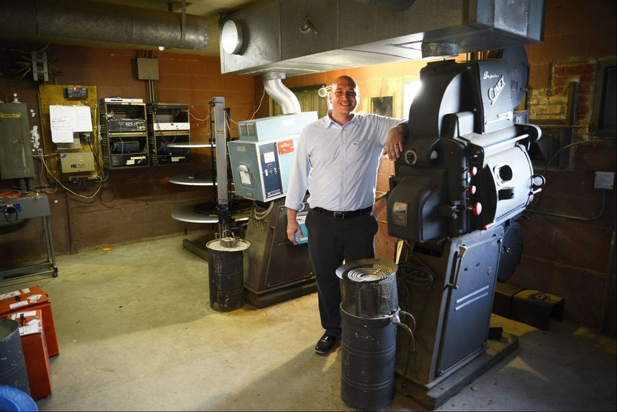 Scott Dehn, owner of McHenry Outdoor Theater, has started a fundraising campaign to pay for a new digital projector that he says would allow the 75-year-old theater to stay in business. The cast iron projector at right was used in the 1940s and is still in place. The film projector at left has been in use for almost 50 years.