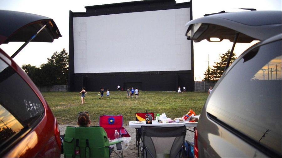 Families sometimes come as early as 3 p.m. to get a spot for the nightly double features at the McHenry Outdoor Theater.