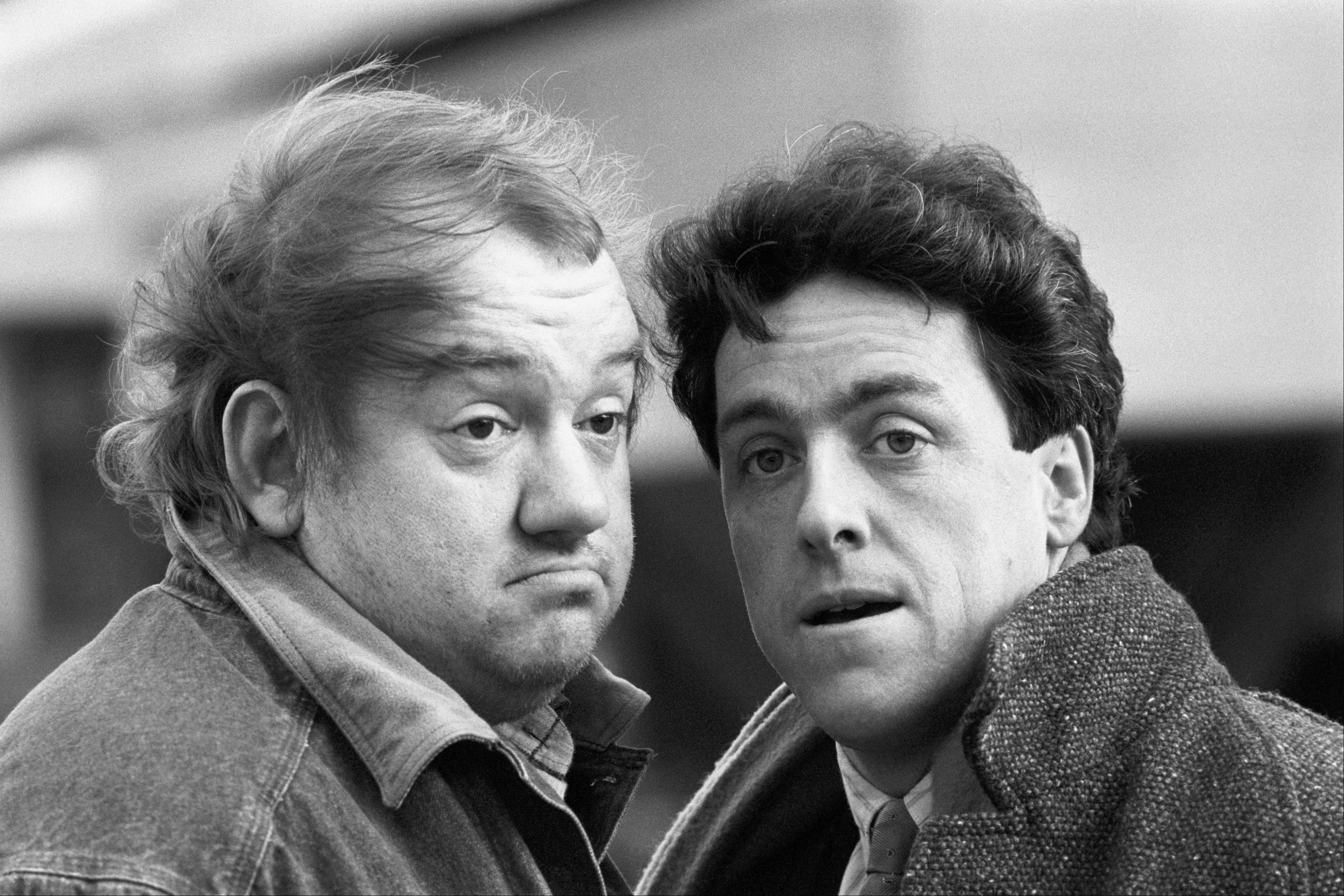 FILE - May 1987 photo of British comedians Mel Smith (left) and Griff Rhys Jones. Smith has died from a heart attack at his home in north west London, his agent Michael Foster has said Saturday July 20, 2013.(AP Photo/ PA) UNITED KINGDOM OUT - NO SALES - NO ARCHIVES