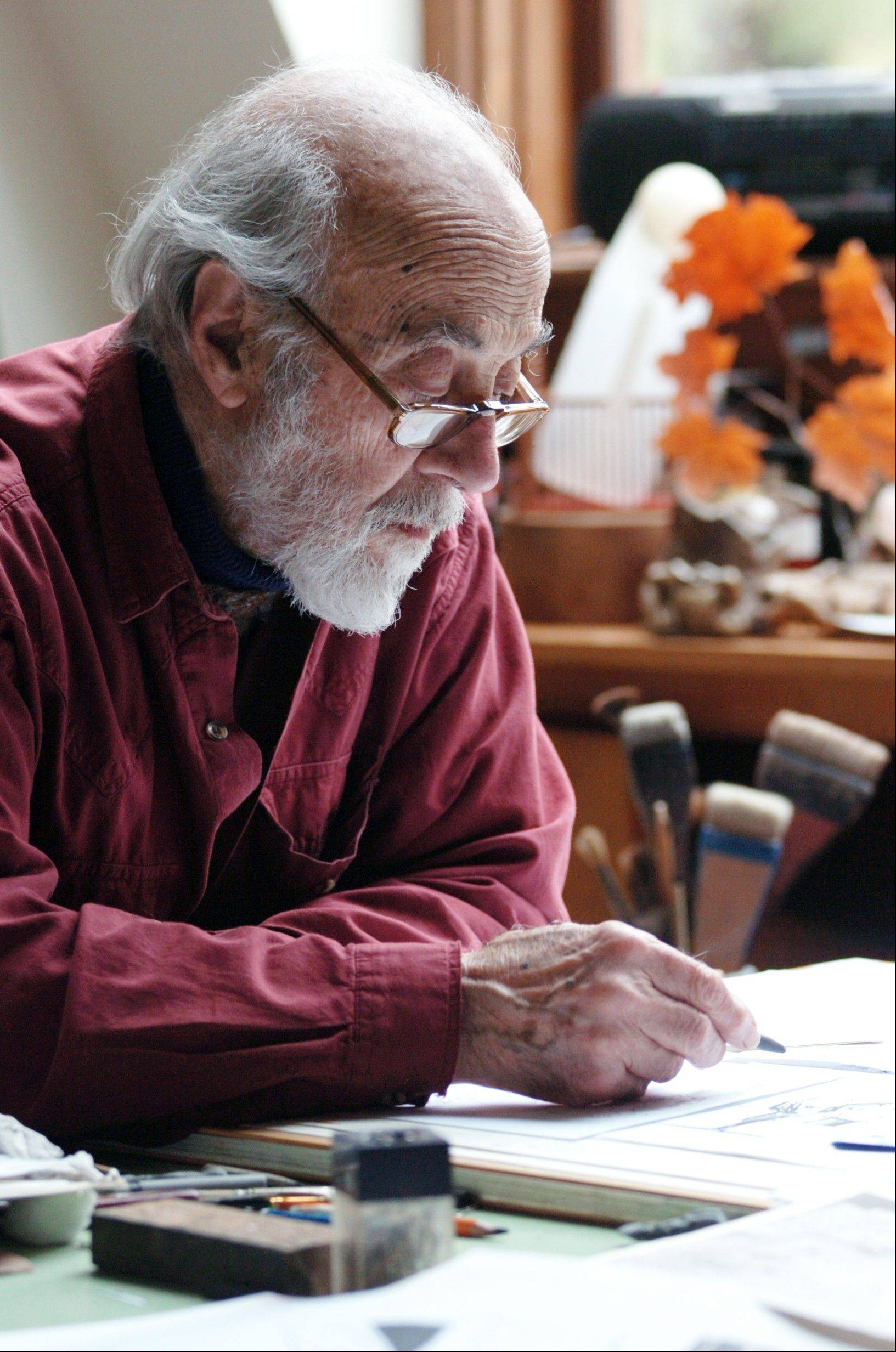 In this February 2010 photo, Marc Simont works at his desk at home in West Cornwall, Conn. Simont, an illustrator whose work adorned some of the most celebrated titles in children's literature, has died at his home in Cornwall, Saturday July 13, 2013. He was 97.