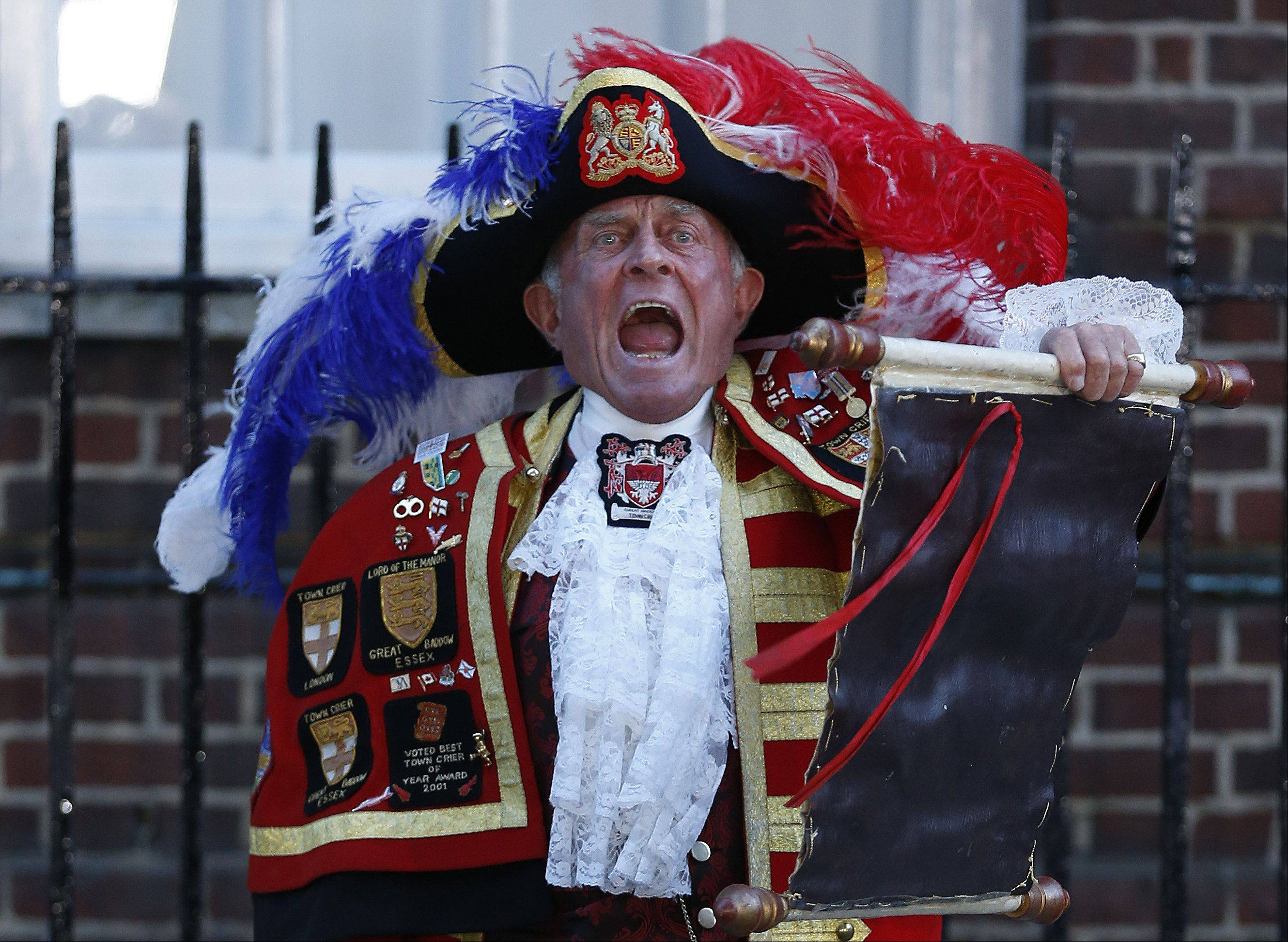 Tony Appleton, a town crier, announces the birth of the royal baby, outside St. Mary's Hospital exclusive Lindo Wing in London, Monday, July 22, 2013. Palace officials say Prince William's wife Kate has given birth to a baby boy. The baby was born at 4:24 p.m. and weighs 8 pounds 6 ounces. The infant will become third in line for the British throne after Prince Charles and William.