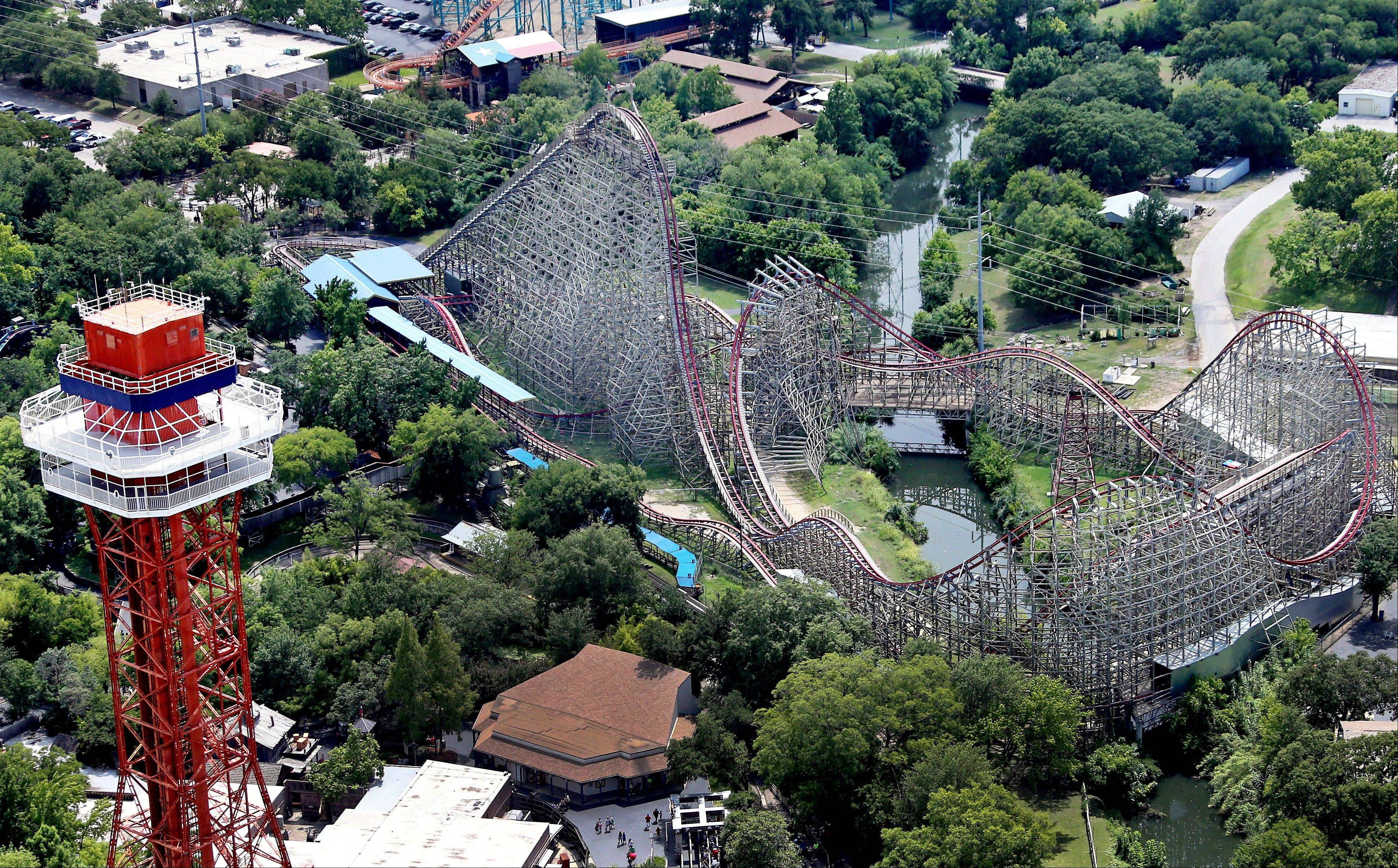 This aerial photo shows the Texas Giant roller coaster at Six Flags Over Texas where a woman fell to her death Saturday in Arlington, Texas.