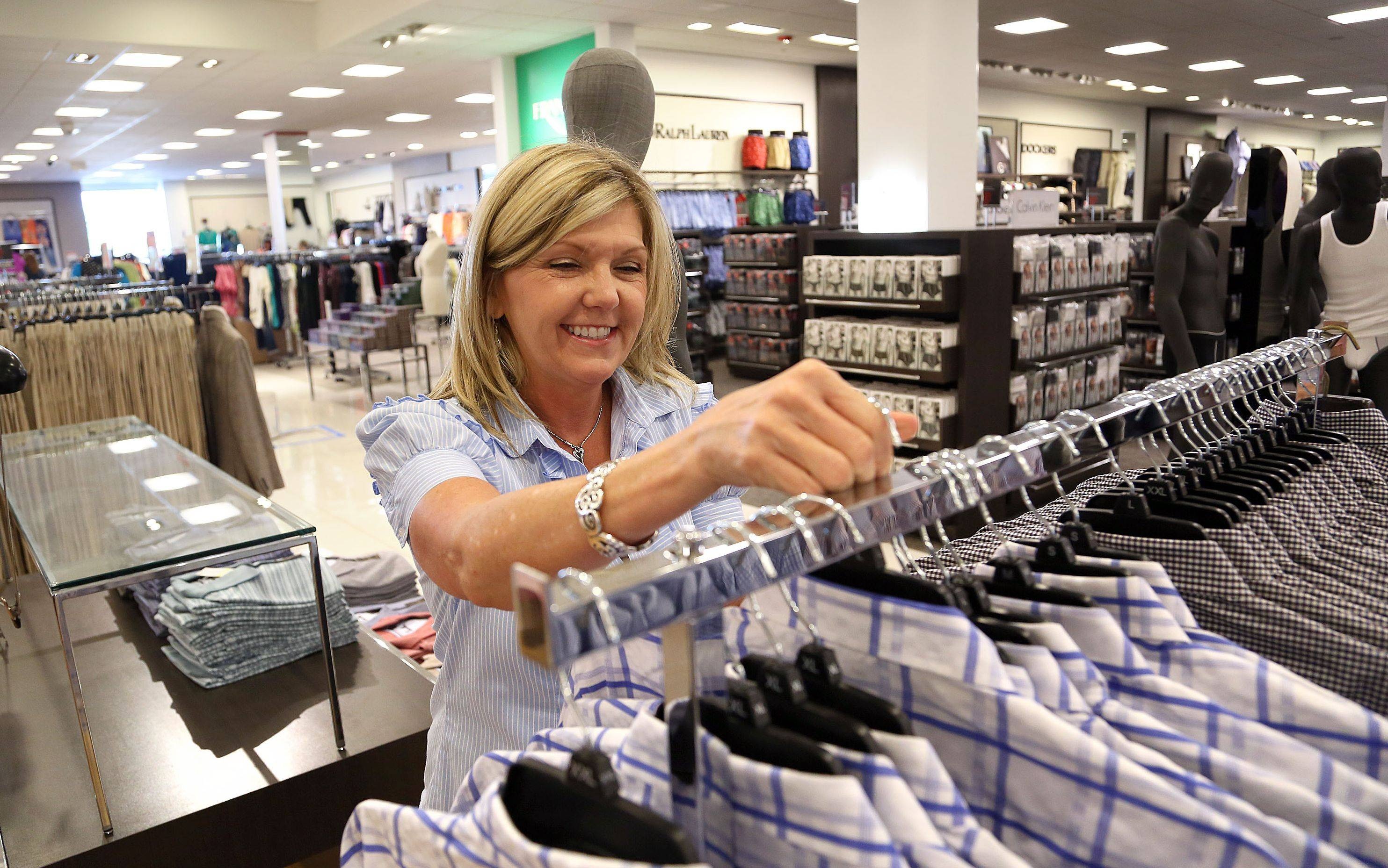 Macy's sales associate Tammy Adcock loads a rack of shirts in preparation for Wednesday's grand opening at Gurnee Mills.