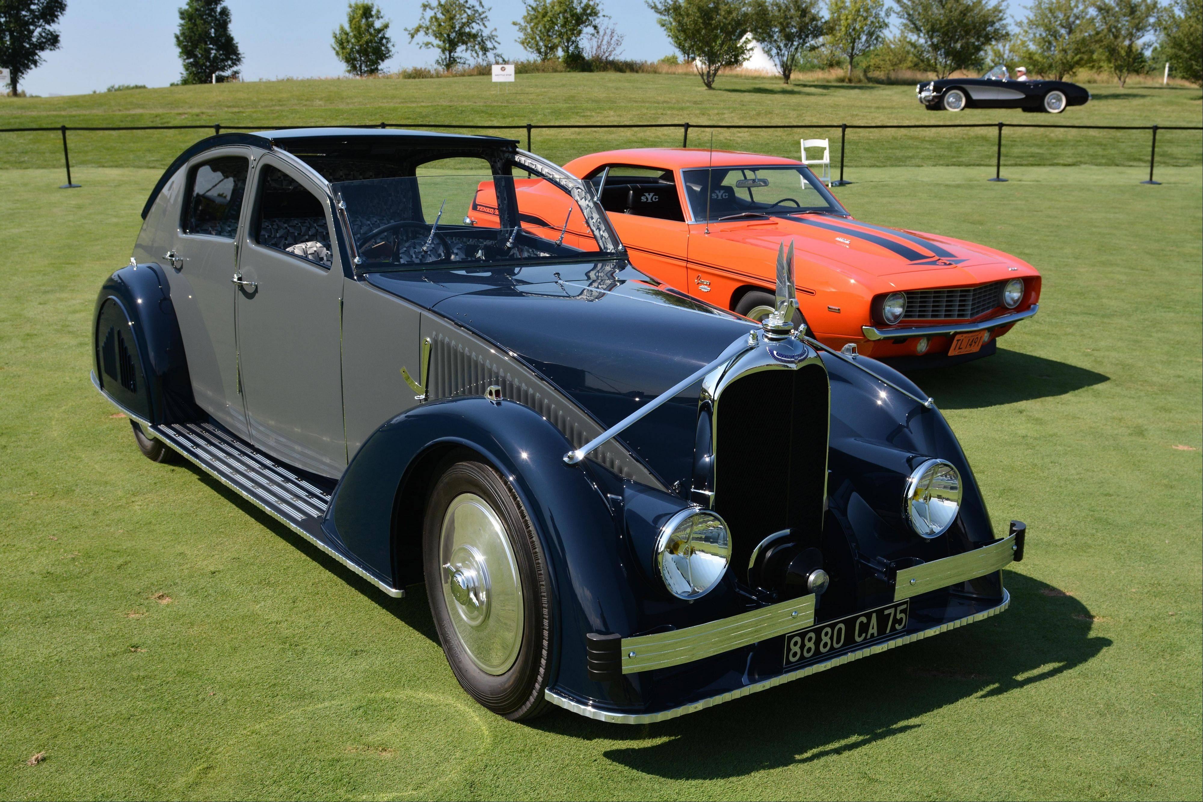 A 1935 Avions Voisin Type C25 Aerodyne, shown in foreground, owned by Peter Mullin of the Mullin Automotive Museum in Oxnard, Calif., earned Best of Show honors.