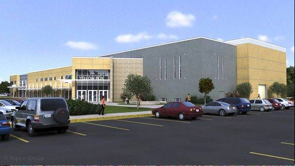 "Community Christian Church's ""Yellow Box"" campus in Naperville is constructing an 18,000-square-foot auditorium and updating its lobby into a training center."