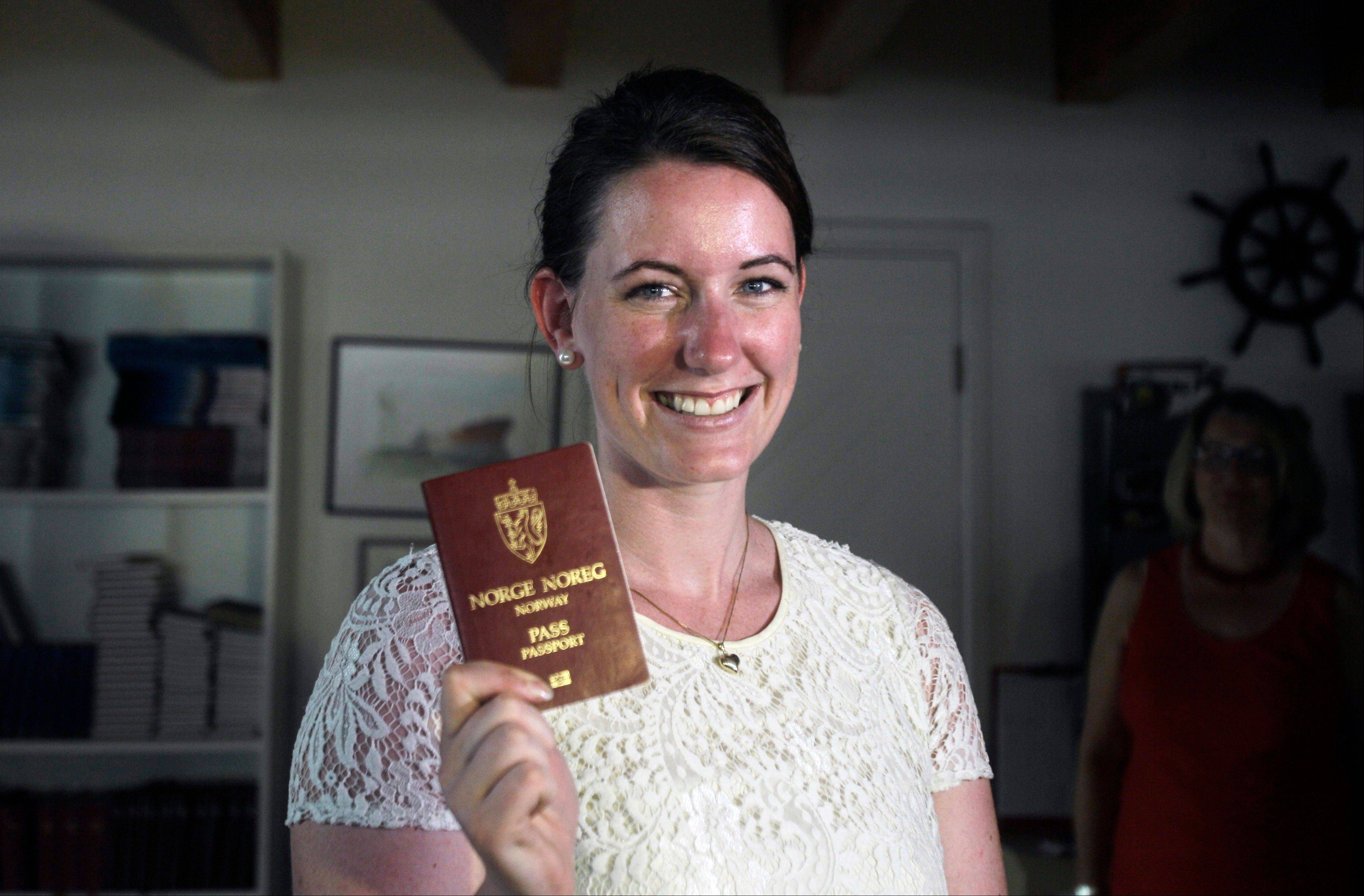 Norwegian Marte Deborah Dalelv, 24, shows her passport at the Norwegian Seaman's Club in Dubai, United Arab Emirates, Monday. At the center of a Dubai rape claim dispute, she said Sunday officials have dropped her 16-month sentence for having sex outside marriage and she is free to leave the country.