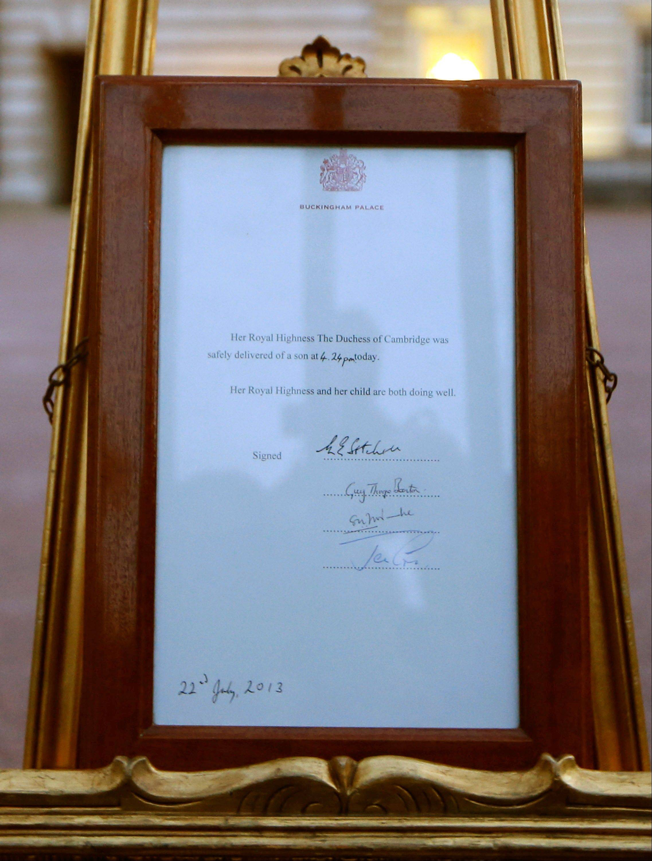 A notice proclaiming the birth of a baby boy to Prince William and Kate, Duchess of Cambridge is displayed for the public view at Buckingham Palace in London, Monday, July 22, 2013.