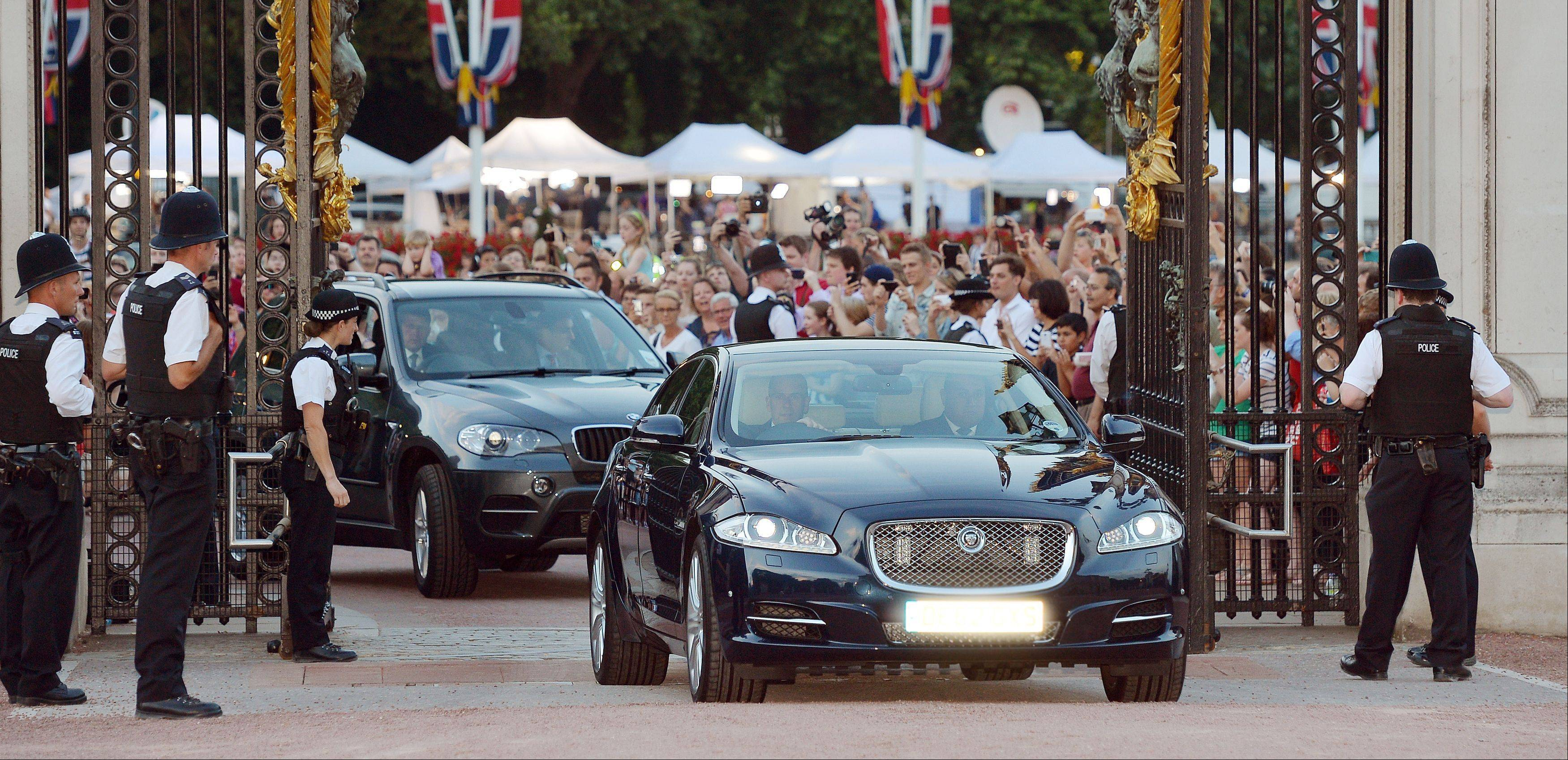 A Jaguar car is driven into the Forecourt of Buckingham Palace bringing the news to announce the birth of a baby boy, at 4.24pm to the Duke and Duchess of Cambridge at St Mary's Hospital in west London, Monday July 22, 2013.