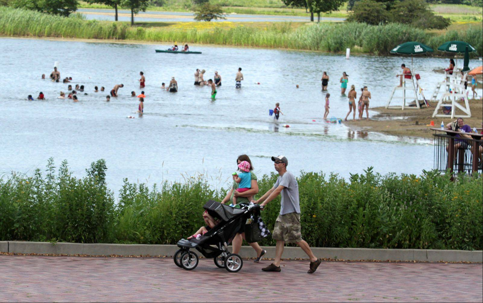 Independence Grove Forest Preserve, which includes a swimming beach, reopened Saturday after being closed for three days because of a bomb threat.