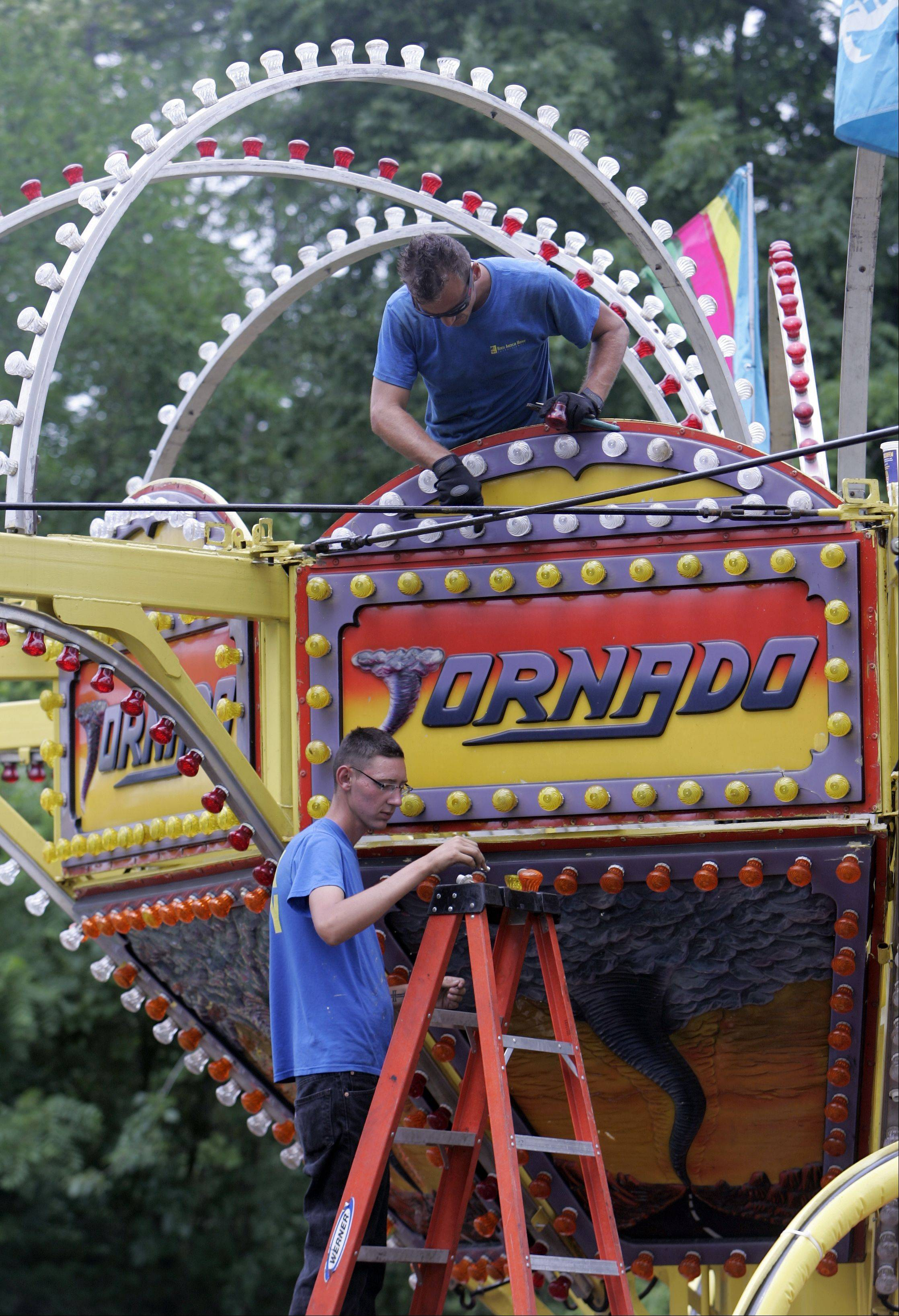 Carnival workers set up rides at last year's Founders' Days festival. This year, because Algonquin Lakes Park offers more room, the number of rides will double.