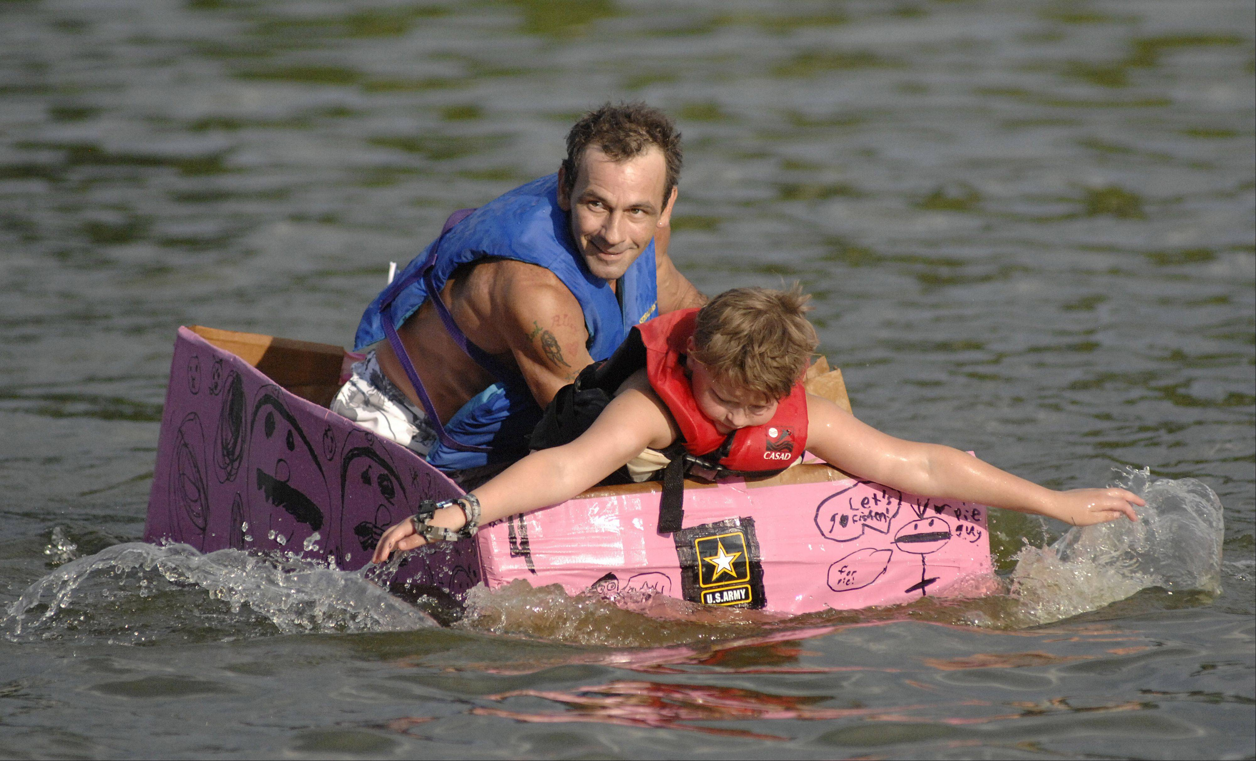 Anthony Porreca, left, helps out Jayden Zea, paddle in Jayden's entry into the Cardboard Boat Regatta at last year's Algonquin Founders' Days.