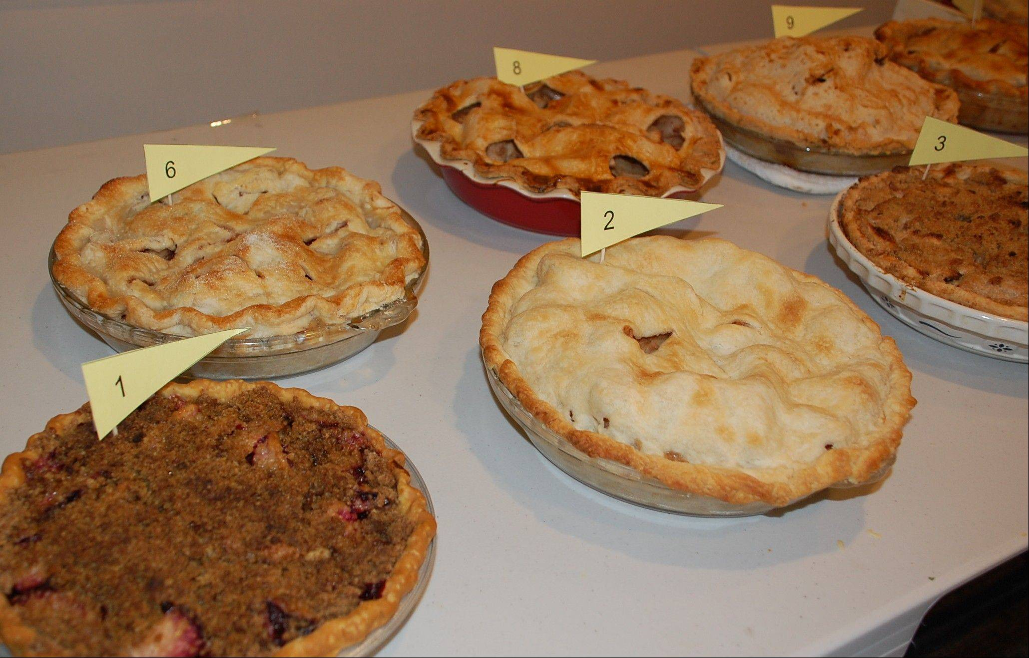 A panel of judges, including our Stephanie Penick, judged pie No. 6 the winner of the 2012 apple pie baking contest at Naper Settlement and declared Beatrice McGovern the winner.