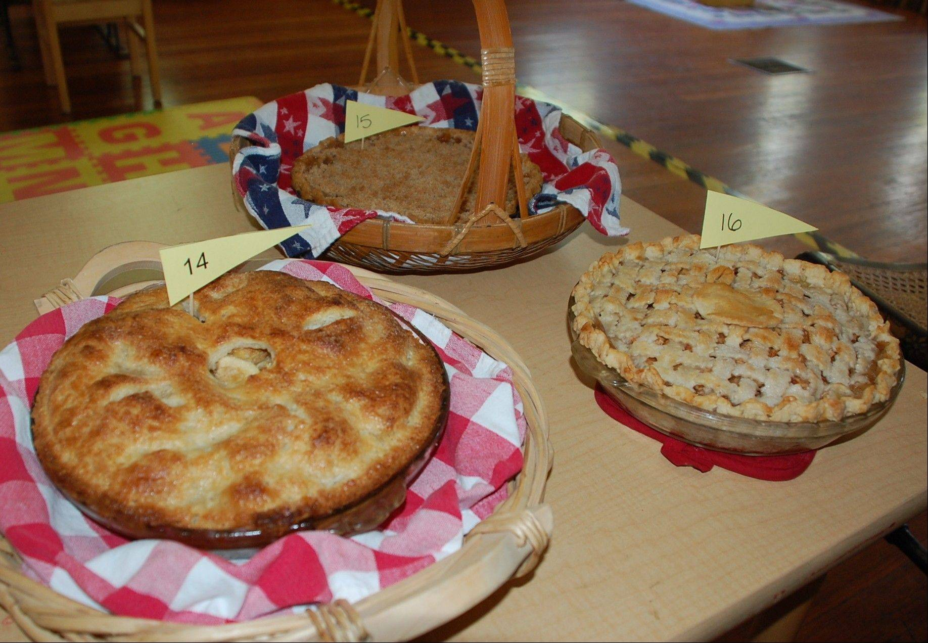 Pies in the apple pie baking contest at Naper Settlement's Hometown Picnic are judged on taste as well as overall presentation.