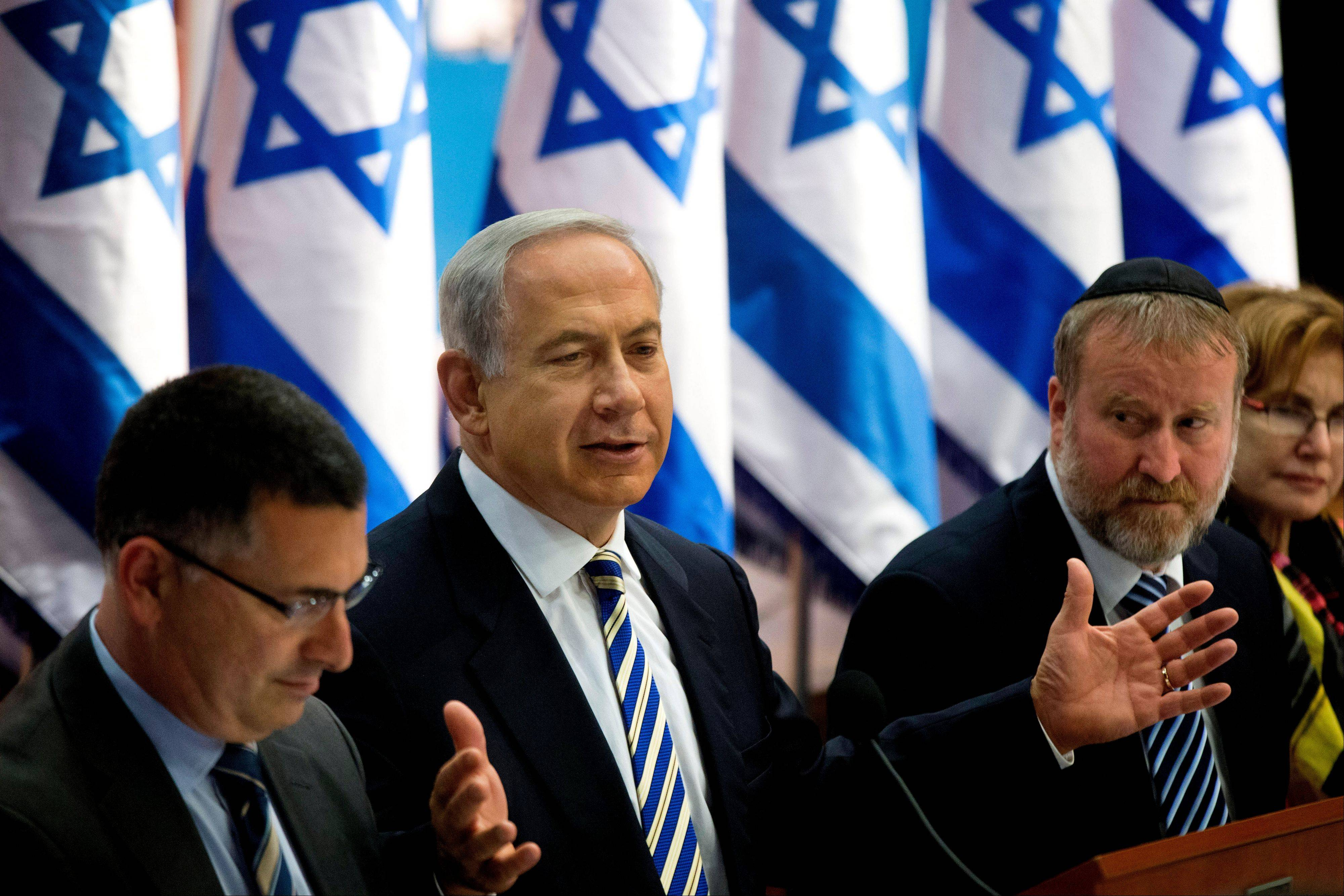 Israel's Prime Minister Benjamin Netanyahu, center, speaks during the weekly cabinet meeting in Jerusalem, Sunday, July 21, 2013. Netanyahu says he is fast-tracking legislation that will allow him to put any future peace deal with the Palestinians to a referendum in Israel.