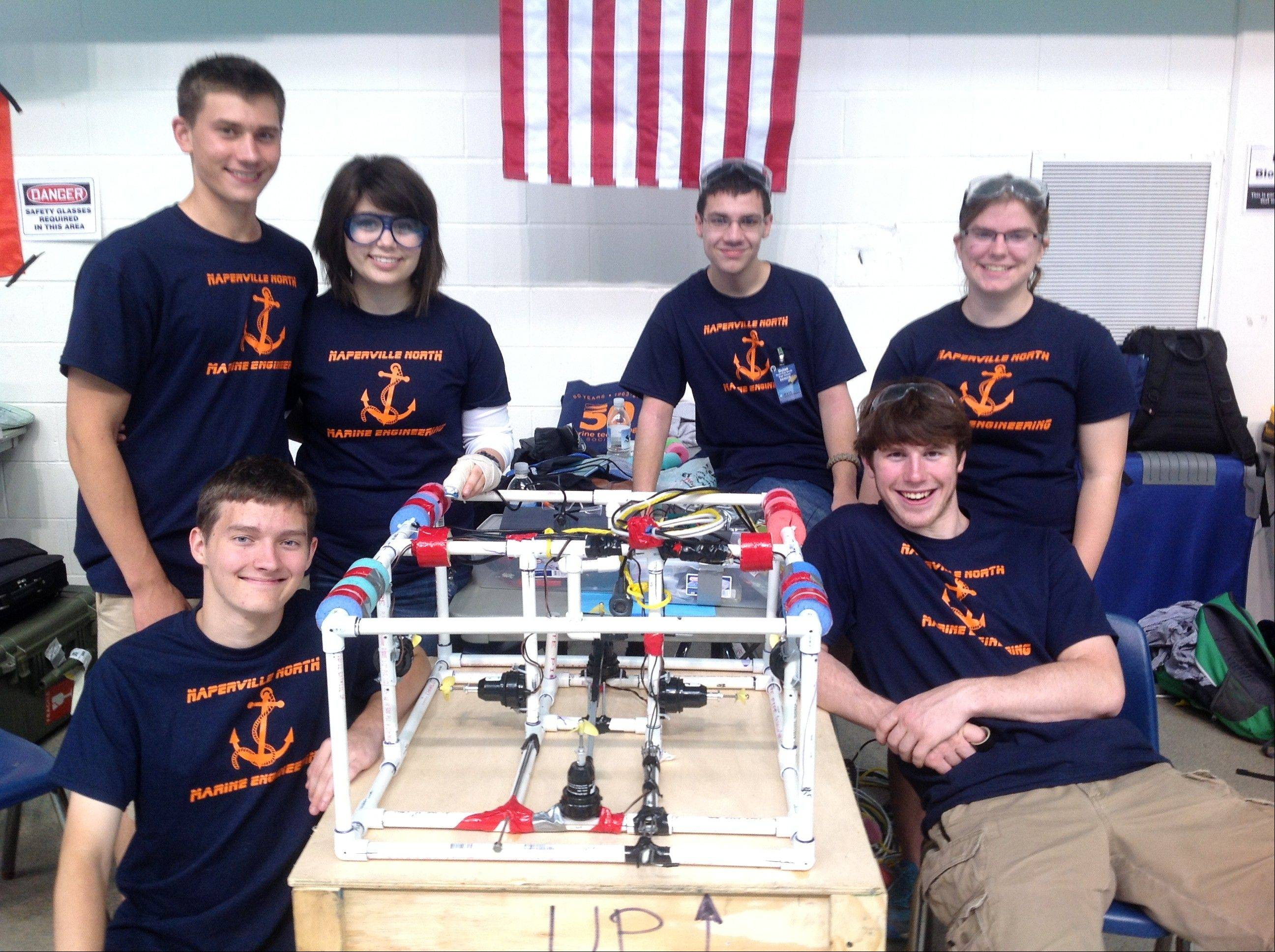 Naperville North High School's marine engineering team, a subsection of the physics club, is Stuart Houston, Isaac Heine, Carissa Cesarotti, Dylan Coupe, Julie Ozols and Konrad Hausman. The team built a remotely operated vehicle to complete scientific tasks underwater in an international competition in June.