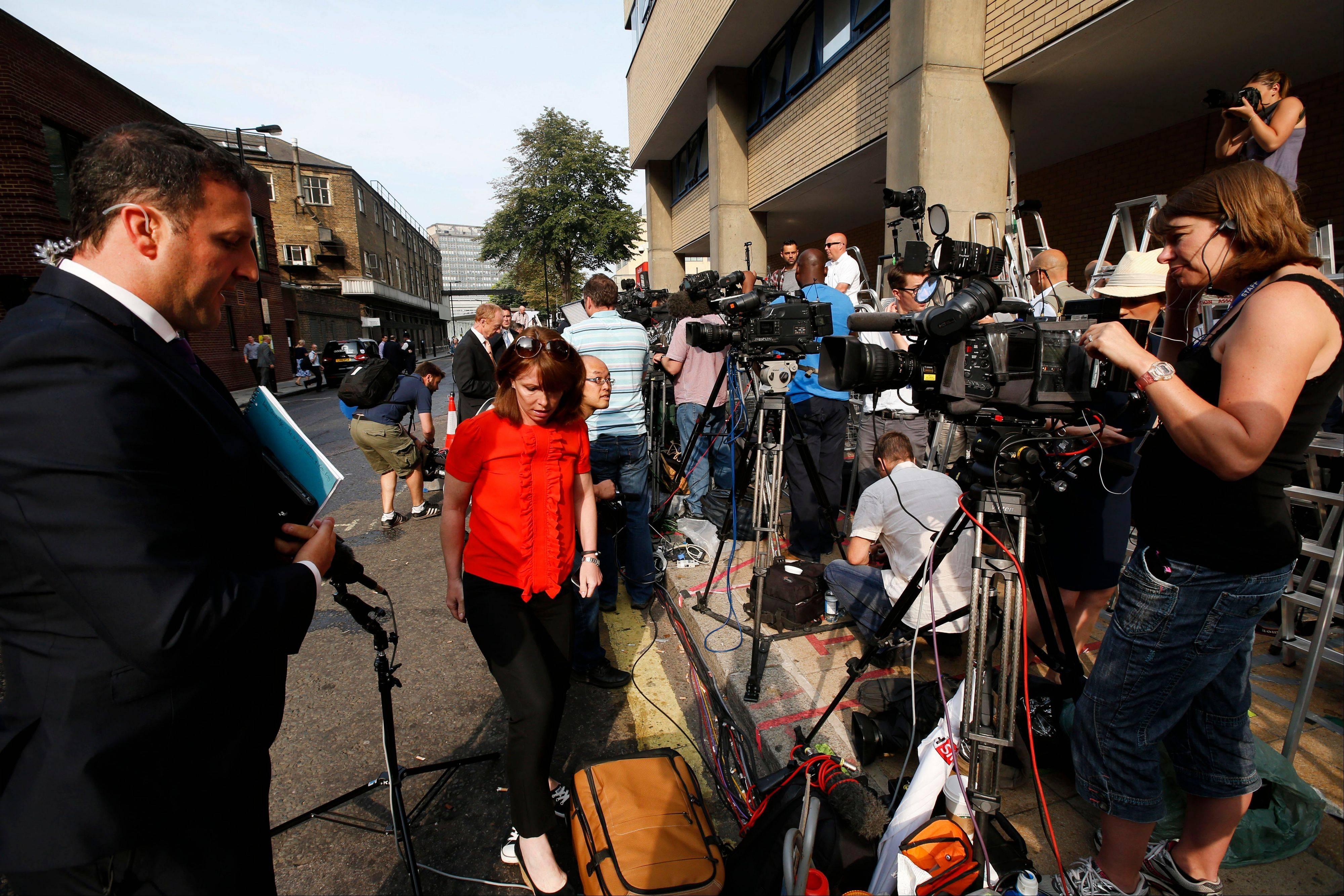 Members of the broadcast media give live reports across from St. Mary's Hospital exclusive Lindo Wing in London, Monday.