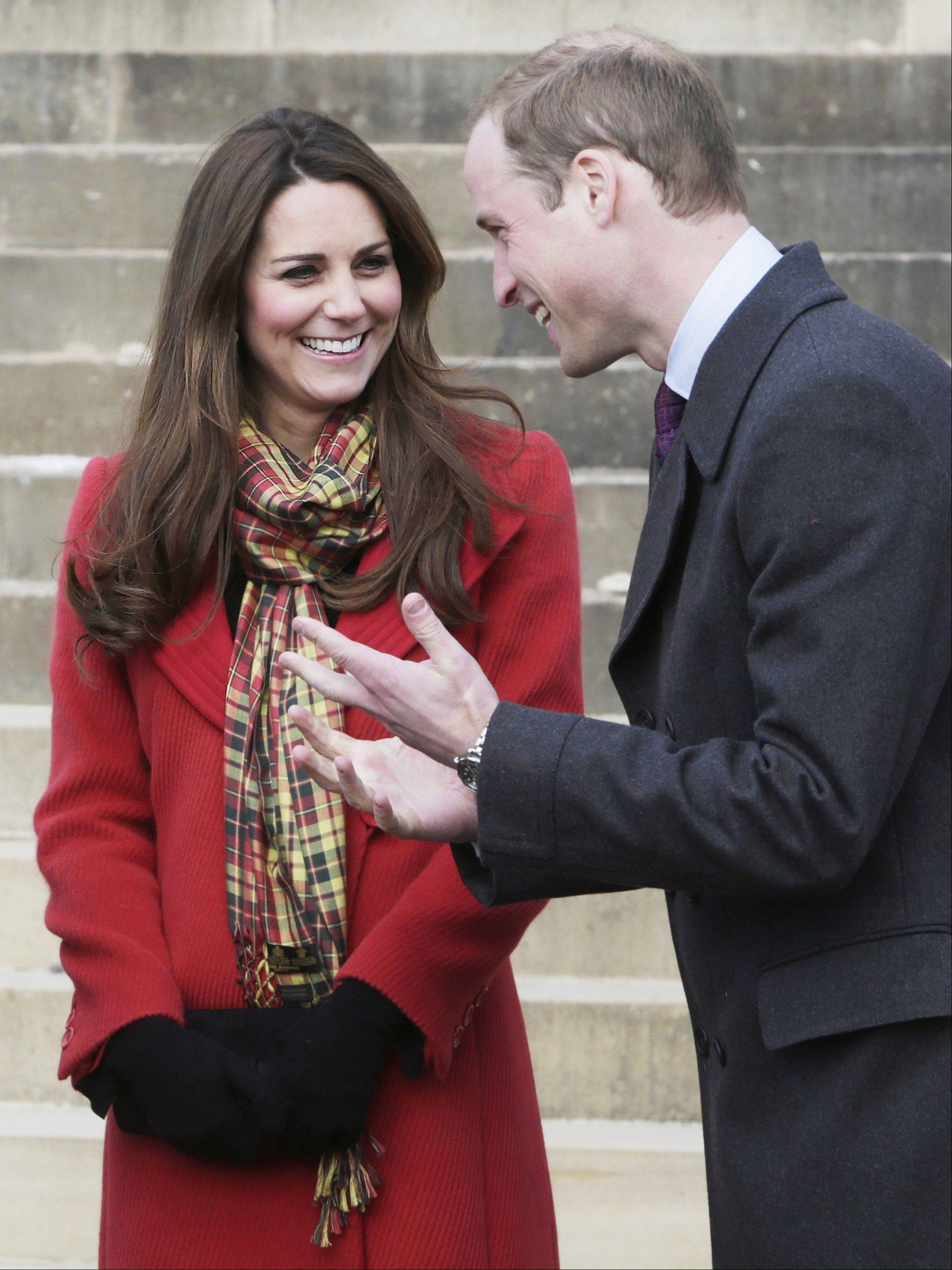 This is a Friday April 5, 2013 file photo Britain's Prince William and Kate Duchess of Cambridge, smile during a visit to Dumfries House in Dumfries, Scotland, to attend the opening of an outdoor centre.