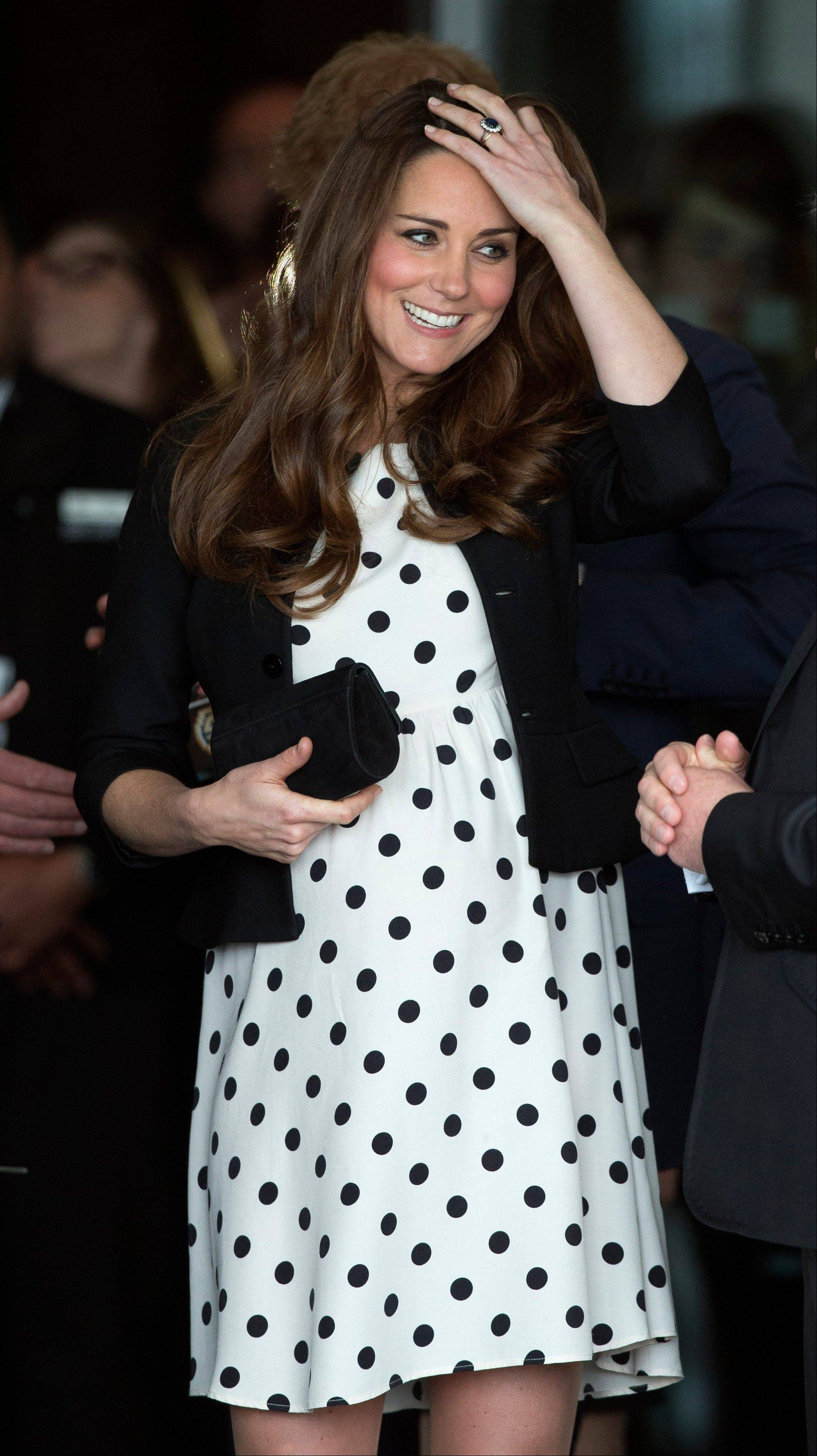 "In this Friday, April 26, 2013 photo Kate the Duchess of Cambridge, her husband Prince William and his brother Prince Harry, both not pictured, leave after attending the inauguration of ""Warner Bros. Studios Leavesden"" near Watford, approximately 18 miles north west of central London."