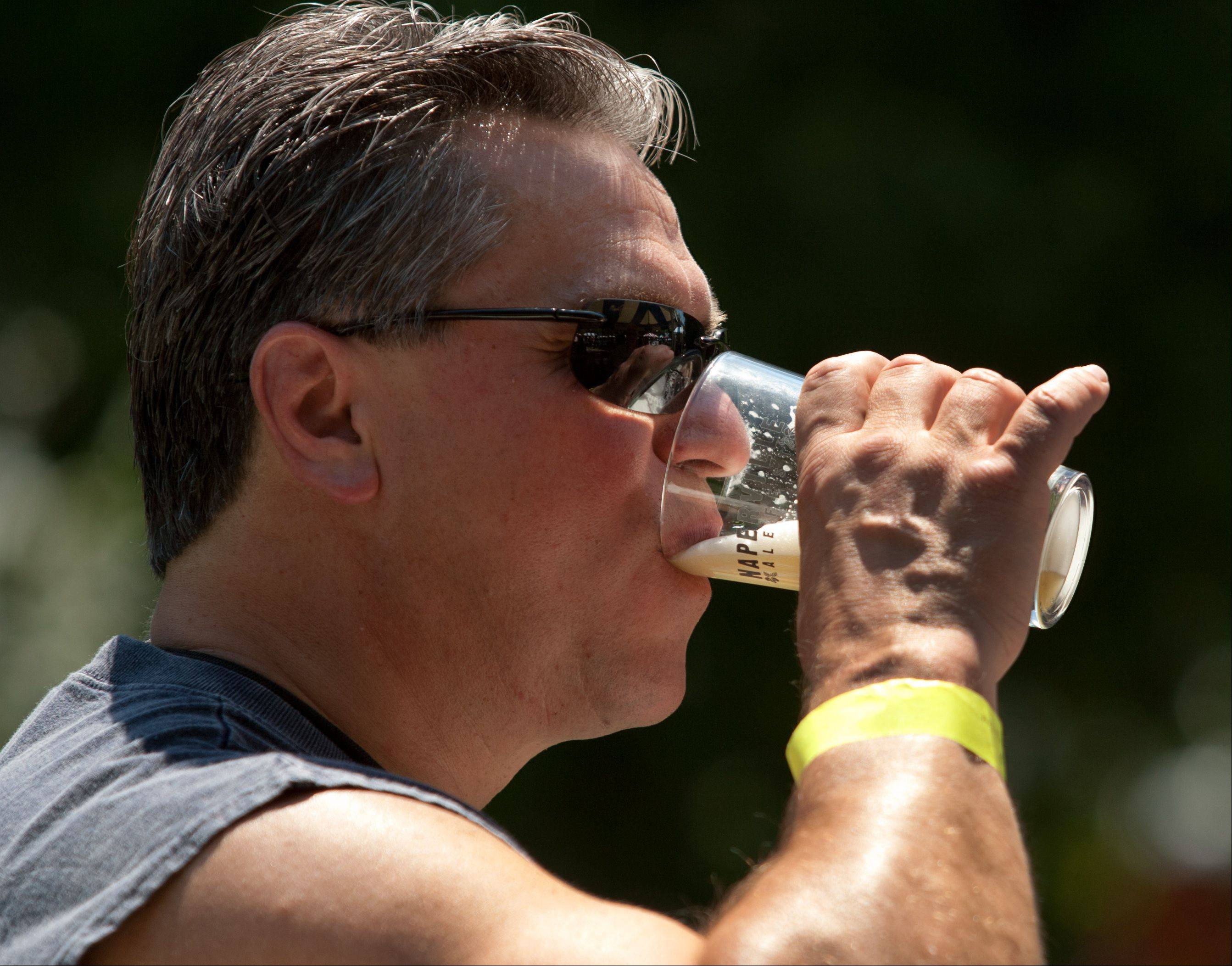 "Joe Macak, of Naperville, sips an Alltech Lexington Brewing sample, during the Naperville Ale Fest at Naper Settlement. ""I'm into home brewing and have built an electronic brewery in my house. It's great to come to these events and see how you do against the pros,"" Macak said."