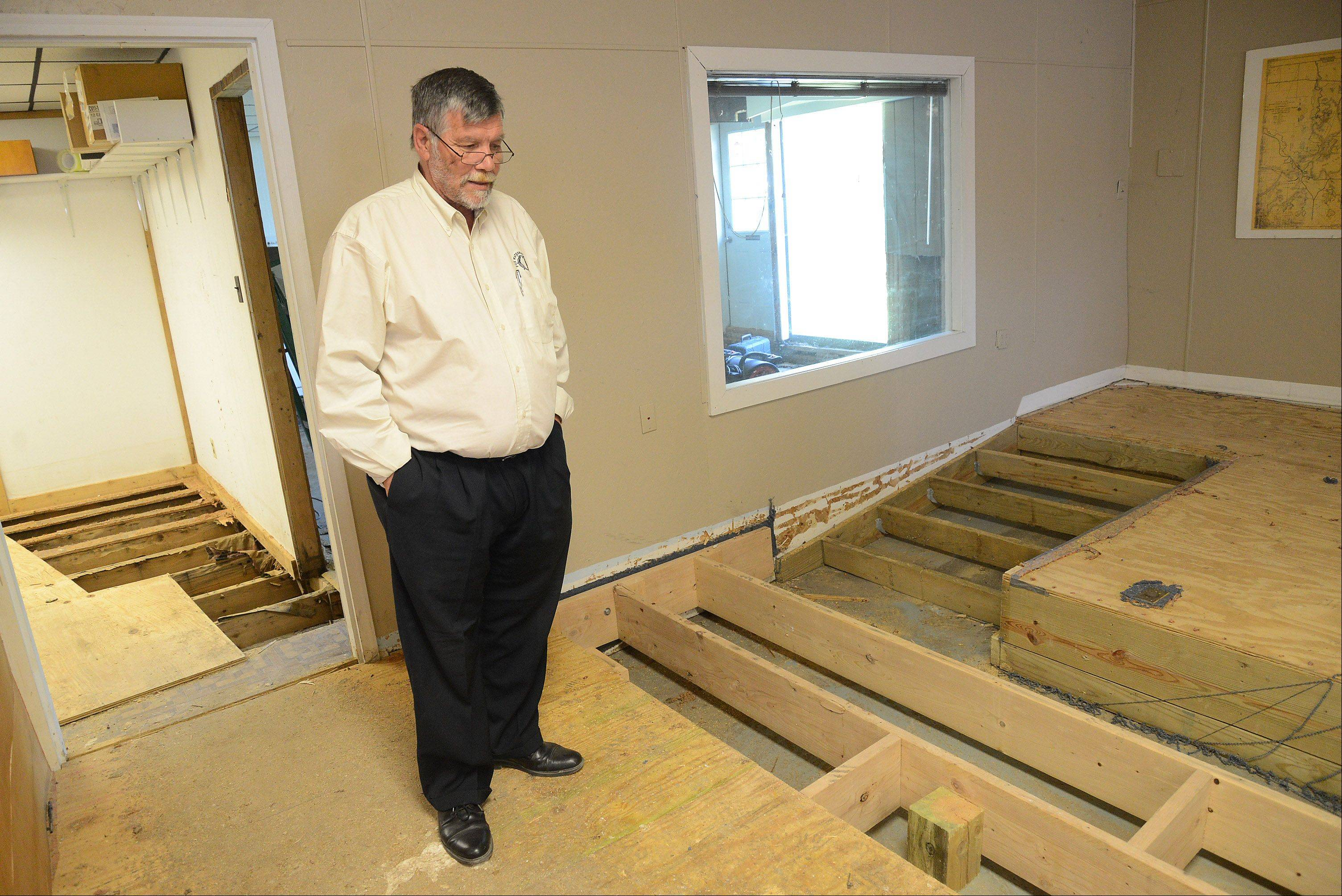 Fox Waterway Agency Executive Director Ron Barker looks over the agency's temporary office space in a trailer. April's floods severely damaged the agency's headquarters in Fox Lake.