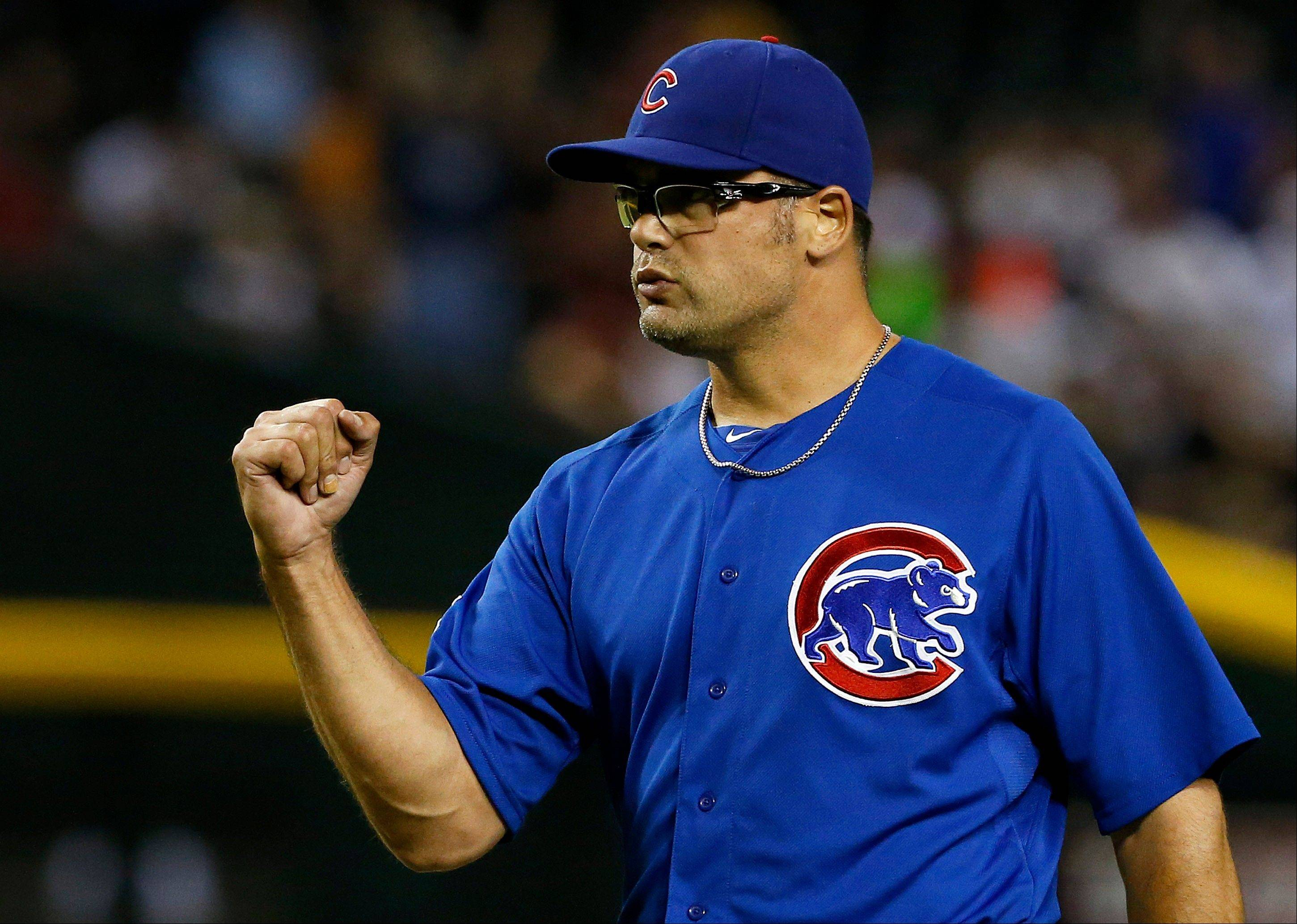 Cubs reliever Kevin Gregg pumps his fist after the final out against the Arizona Diamondbacks on Monday in Phoenix.