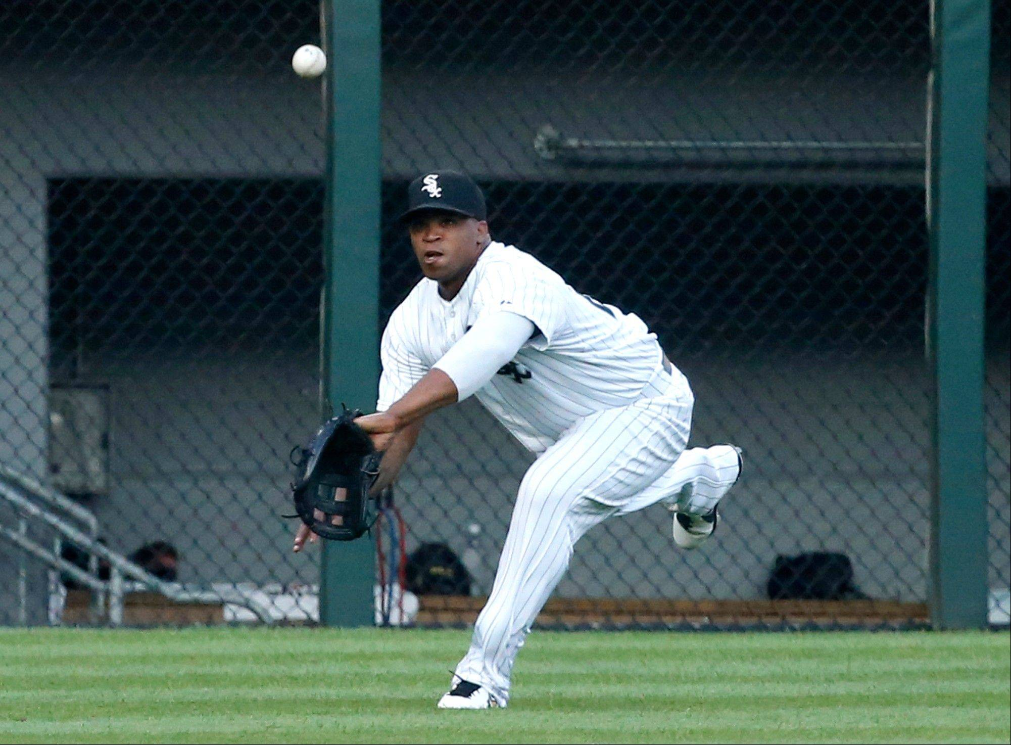 White Sox left fielder Dayan Viciedo makes the catch on a sinking fly ball hit by Detroit's Austin Jackson during the first inning Monday at home.