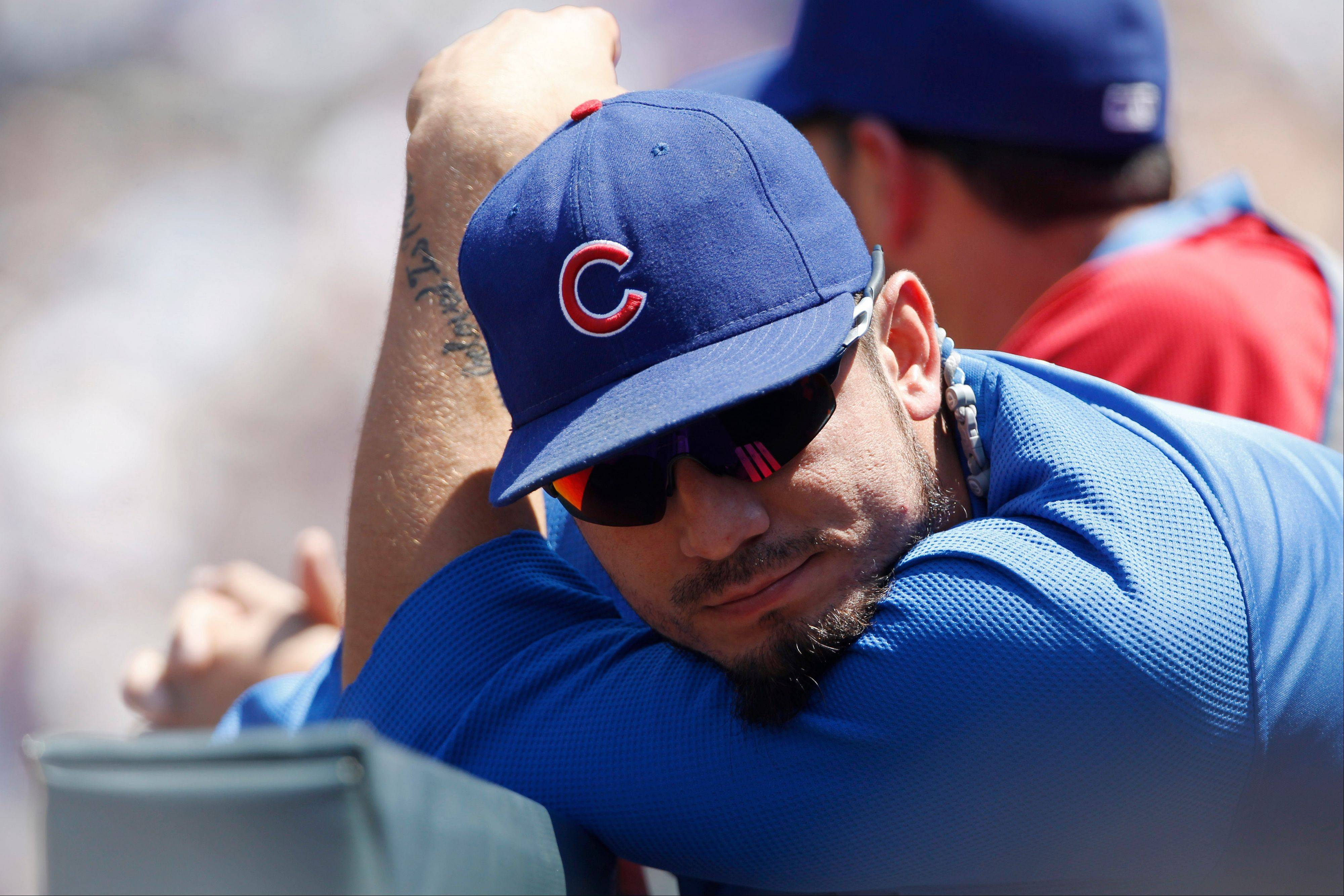 Matt Garza spends what would be his last day in the Cubs' dugout Sunday at Colorado. On Monday, the Cubs traded Garza to the Texas Rangers for four or possibly five prospects.