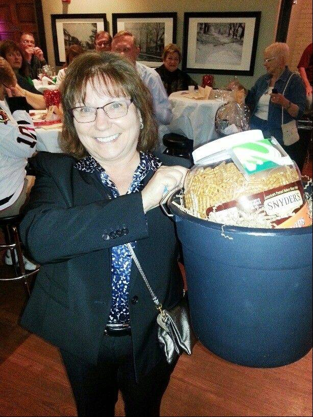 "Deb Armstrong was the winner of the bucket door prize at the ""Beers to You"" fundraiser for the Palatine Township Senior Center."