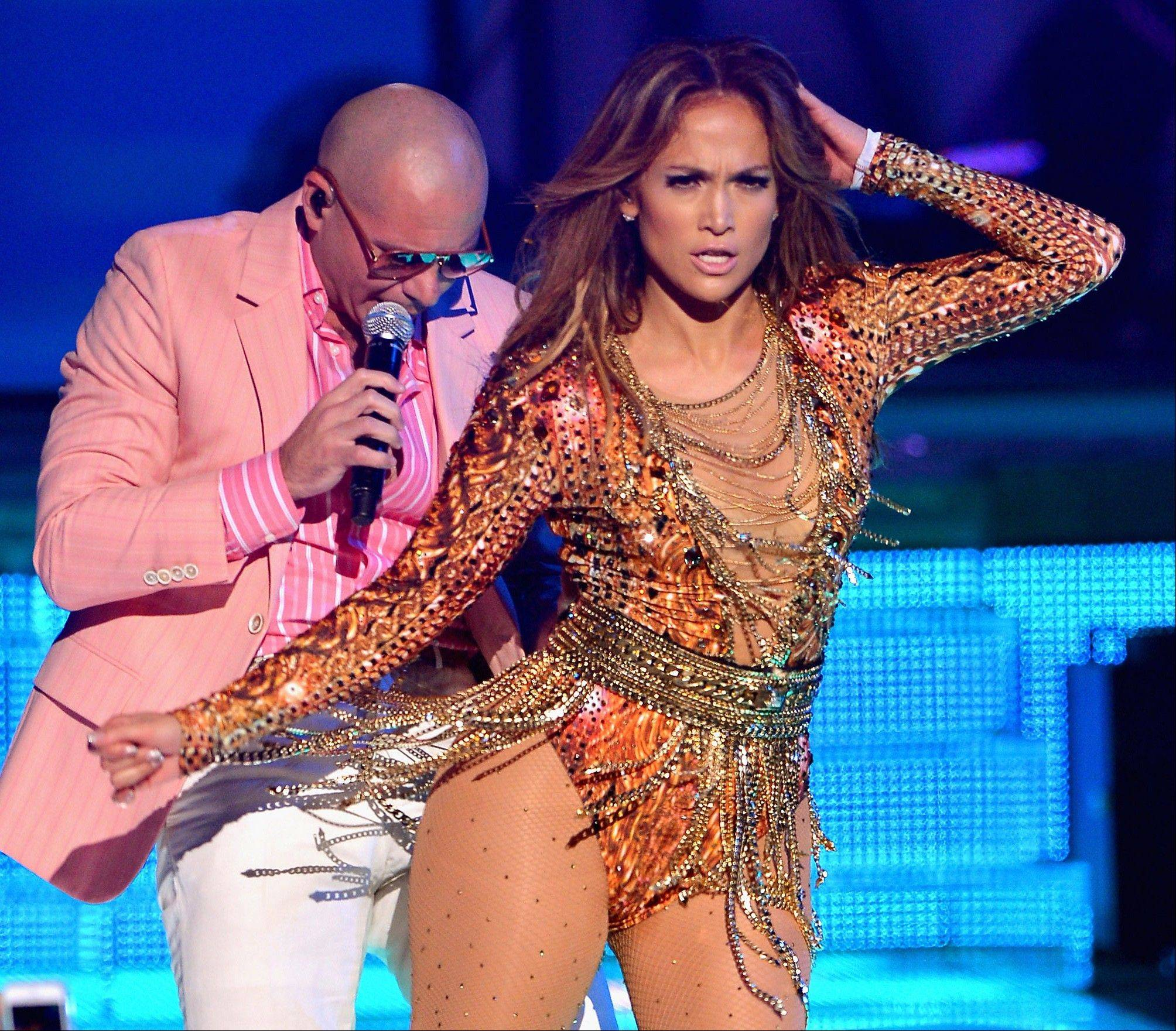 Associated Press/July 18, 2013, from Univision Jennifer Lopez and Pitbull perform during the awards for �Premios Juventud� held at the BankUnited Center at the University of Miami in Coral Gables, Fla. For the first time, the Spanish-language Univision network will have a larger audience than its English counterparts for a full month in the youthful demographic that television advertisers are most eager to reach.