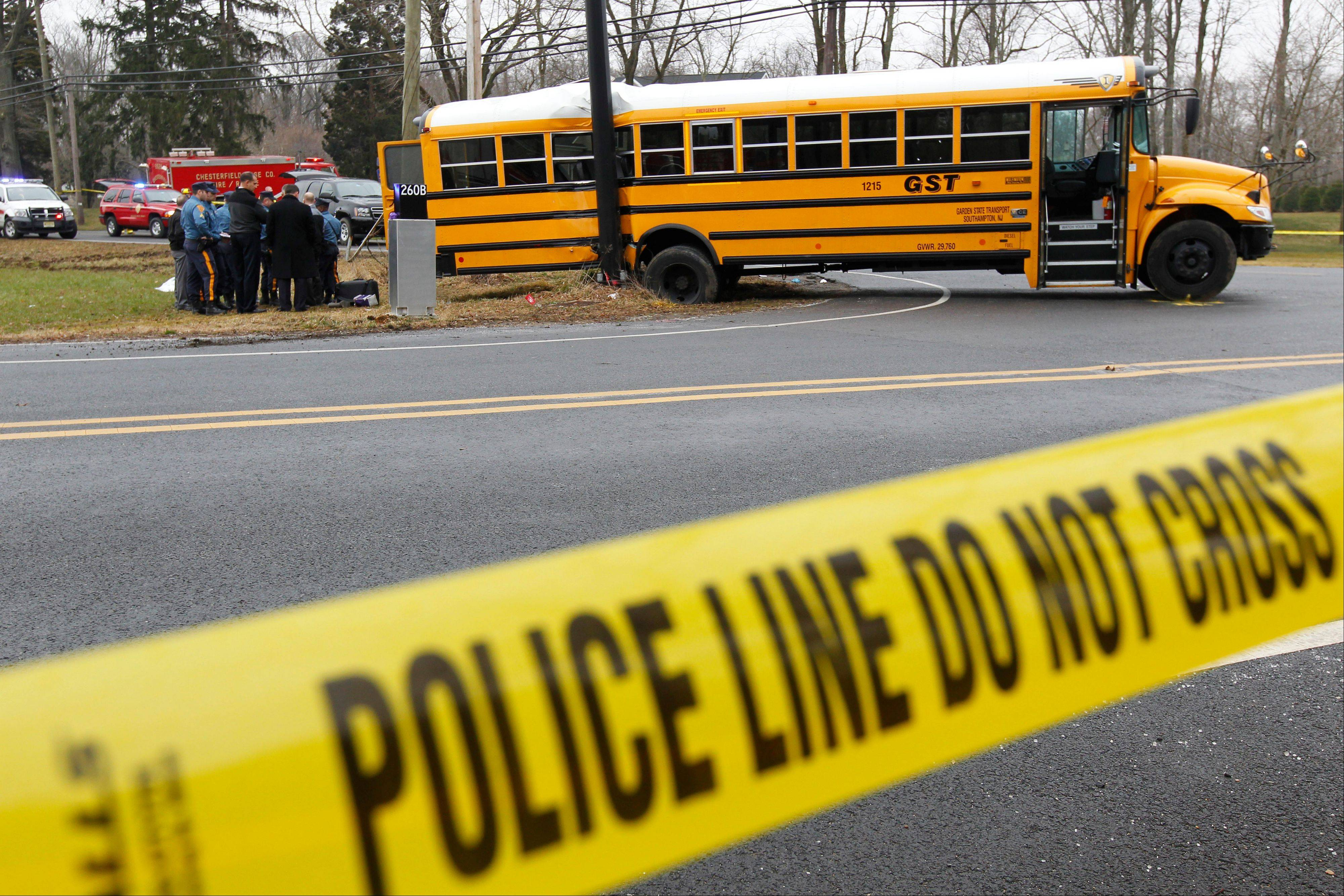Investigators viewing the scene of a school bus crash in Chesterfield, N.J. Federal investigators are expected to make new school bus safety recommendations based on fatal accidents in New Jersey and Florida last year.