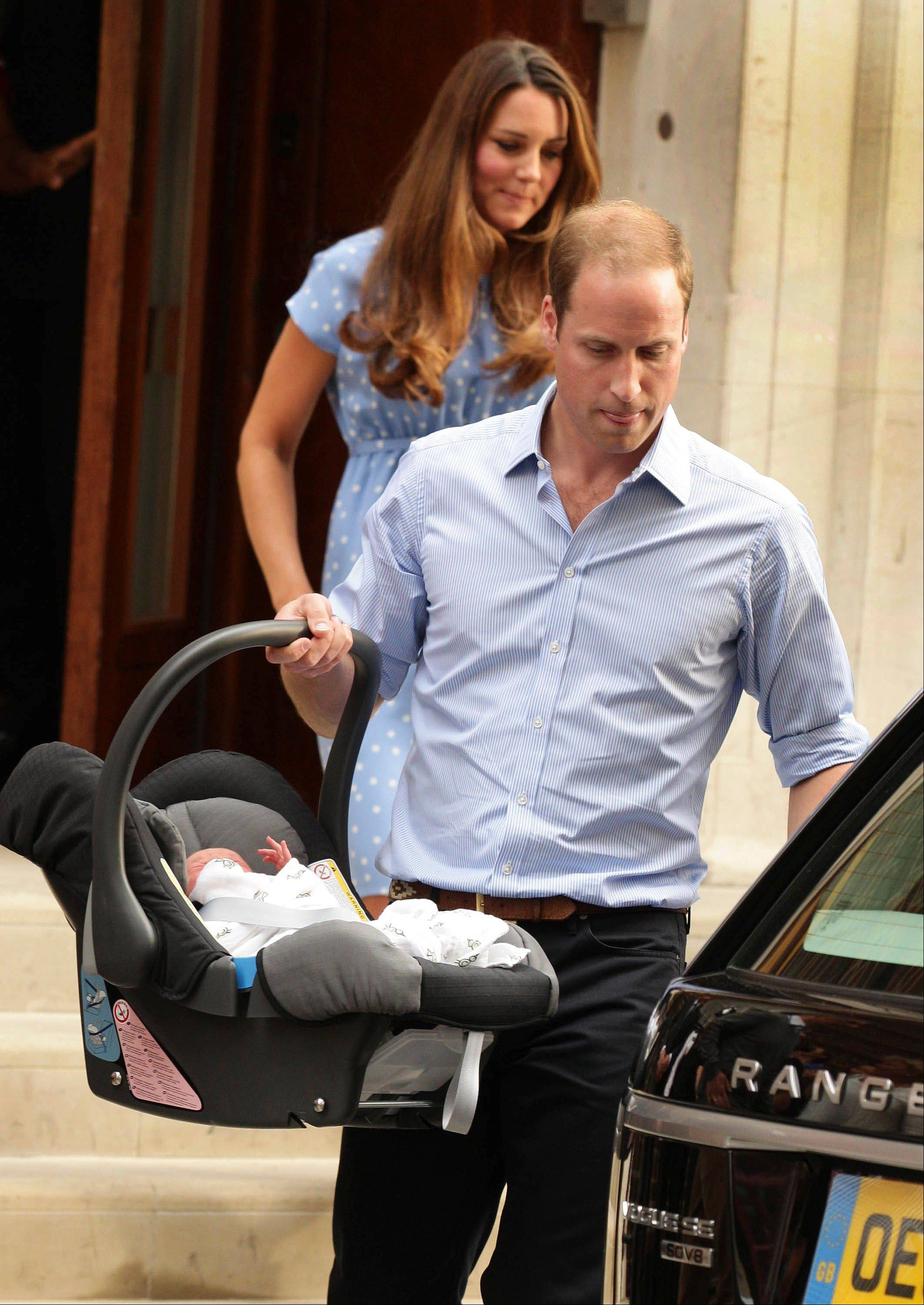 The Duke and Duchess of Cambridge leave the Lindo Wing of St Mary�s Hospital in London Tuesday July 23 2013, carrying their newborn son.