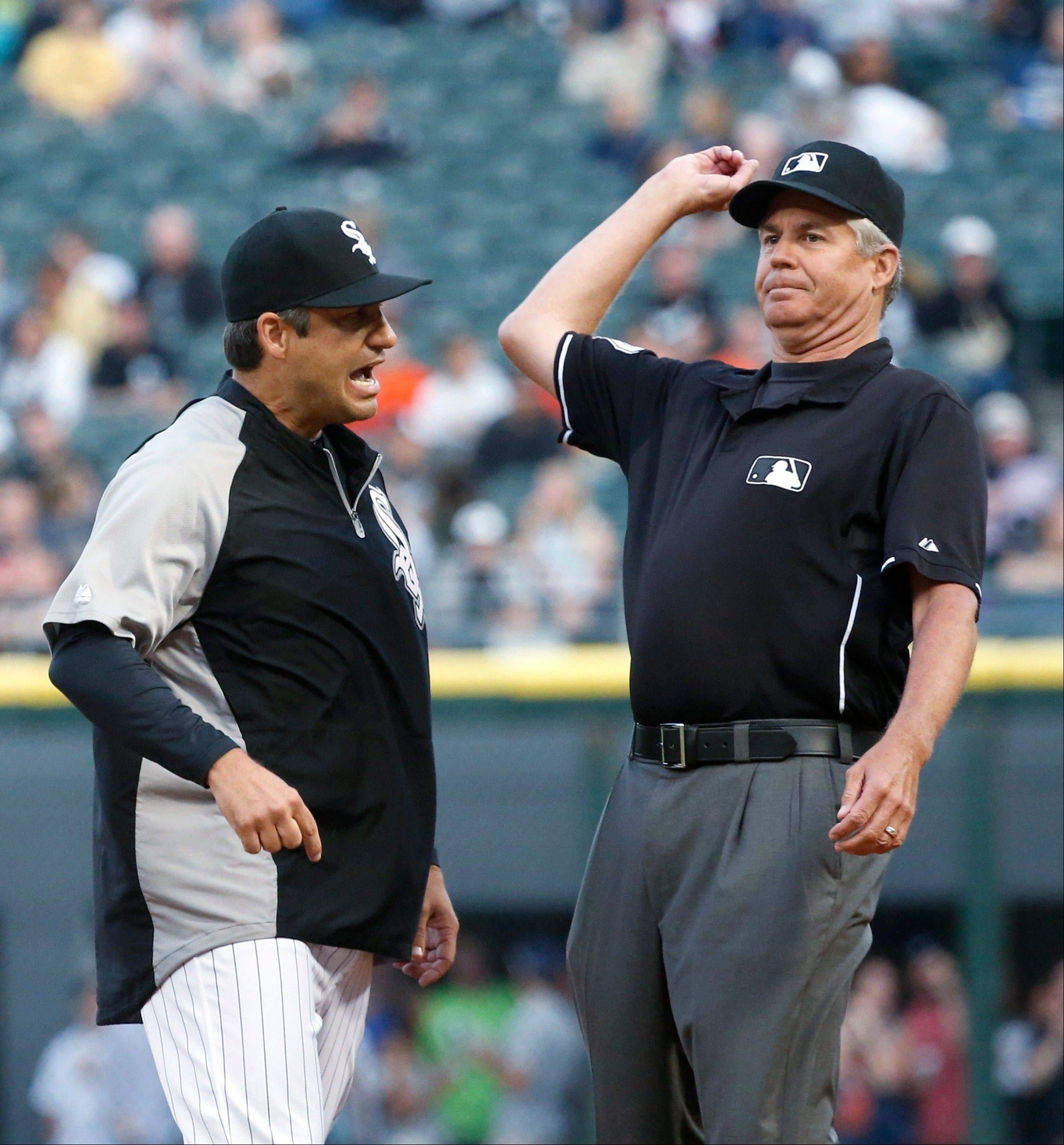 First base umpire Gary Darling, right, throws out Chicago White Sox manager Robin Ventura as Ventura argues Darling's call that first baseman Adam Dunn interfered with Detroit Tigers' Torii Hunter getting back to first on a rundown during the first inning of a baseball game Tuesday, July 23, 2013, in Chicago. (AP Photo/Charles Rex Arbogast)